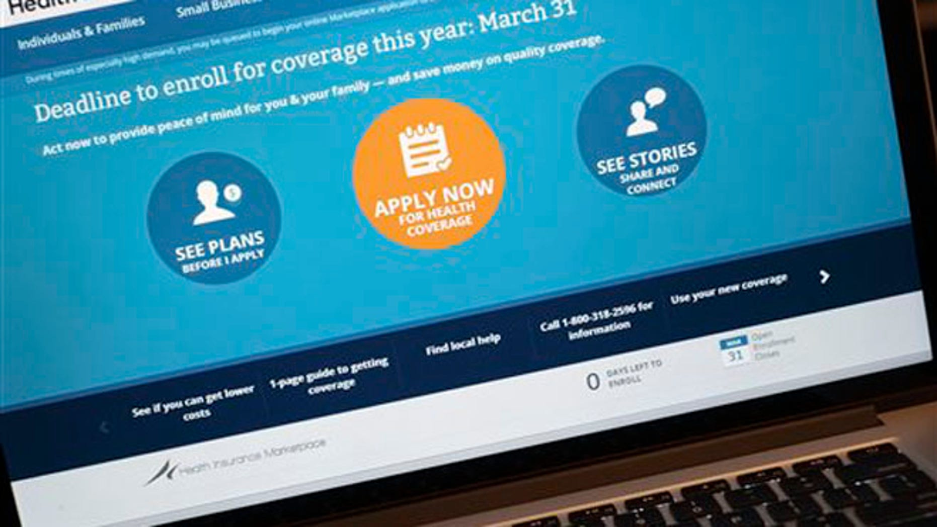 March 31, 2014: The HealthCare.gov website is shown on a laptop.