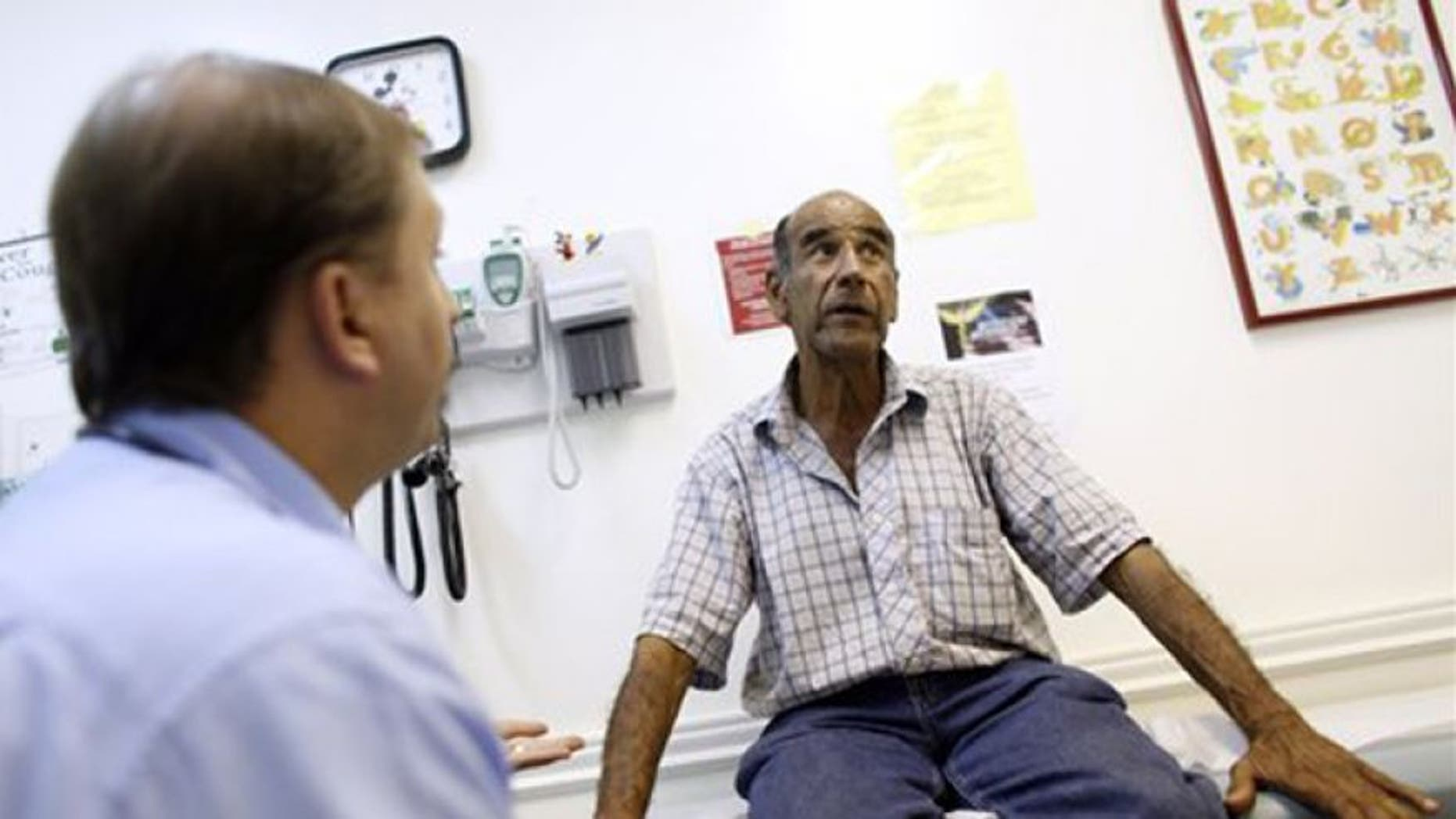FILE: June 27, 2012: A patient talks with a doctor at Camillus Health Concern, in Miami.