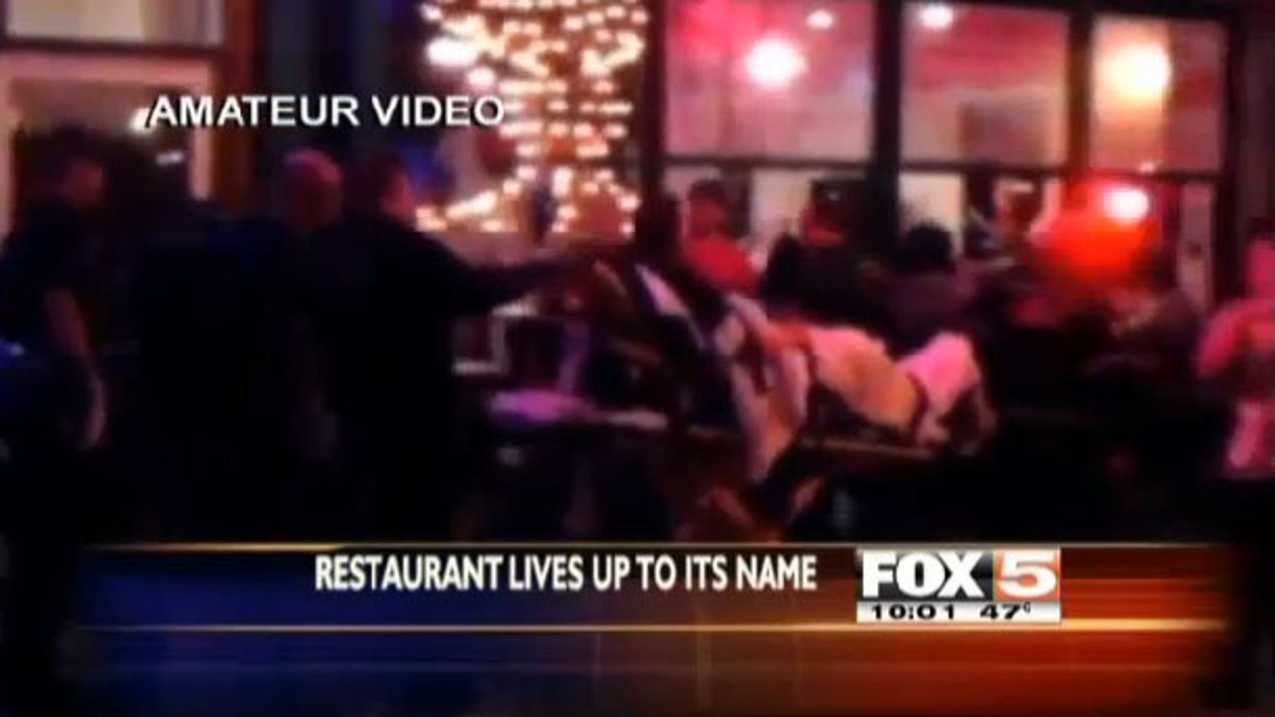 Amateur video of man being rolled out on a stretcher by EMTs after suffering a heart attack at the Heart Attack Grill in Las Vegas.