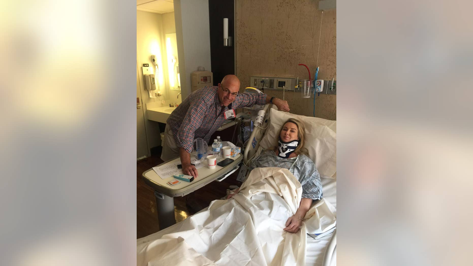 Heather Childers is visited by a friend while recovering after surgery at New York Presbyterian Columbia Medical Center in July