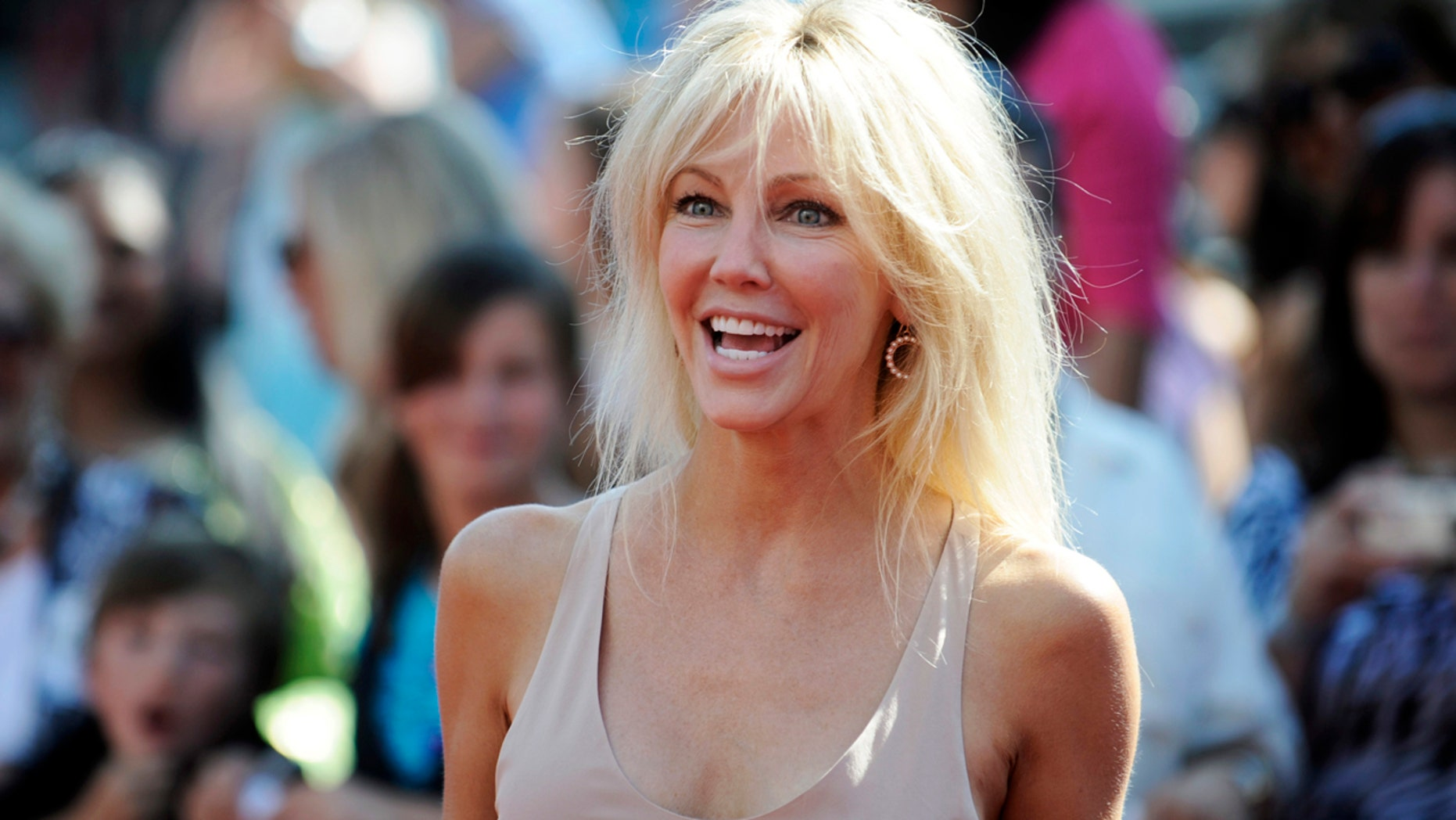 """Actress Heather Locklear arrives for the finale of Season 8 of """"American Idol"""" in Los Angeles May 20, 2009.   REUTERS/Phil McCarten  (UNITED STATES ENTERTAINMENT) - RTXKENK"""