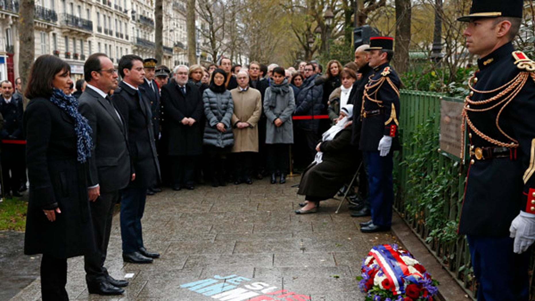 Jan. 5, 2016: French President Francois Hollande, second left, Paris mayor Anne Hidalgo, left, and Prime Minister Manuel Valls unveil a plaque honoring policeman Ahmed Merabet is pictured in Paris.