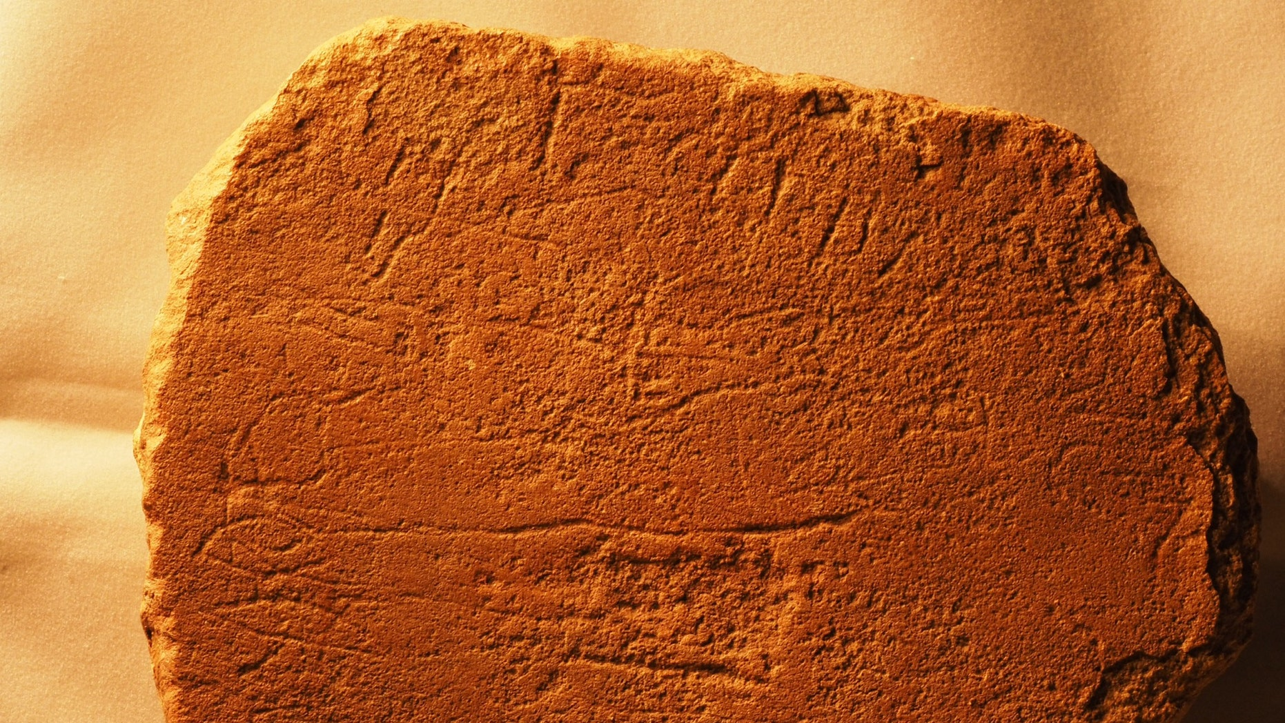 A photo of Sinai 375a, a stone slab from Egypt, which is now located in the Harvard Semitic Museum. This photo contains the name Ahisamach (Exodus 31:6) on the two horizontal lines. (Credit: Douglas Petrovich)