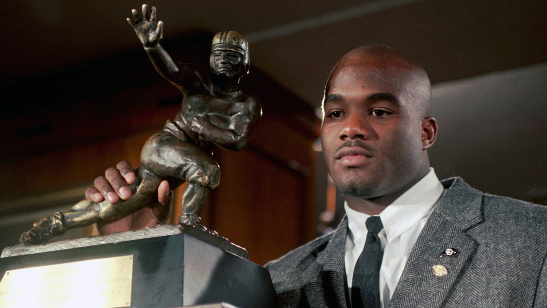 In this Dec. 10, 1994, file photo, Colorado's Rashaan Salaam poses with his 1994 Heisman Trophy at the Downtown Athletic Club in New York.