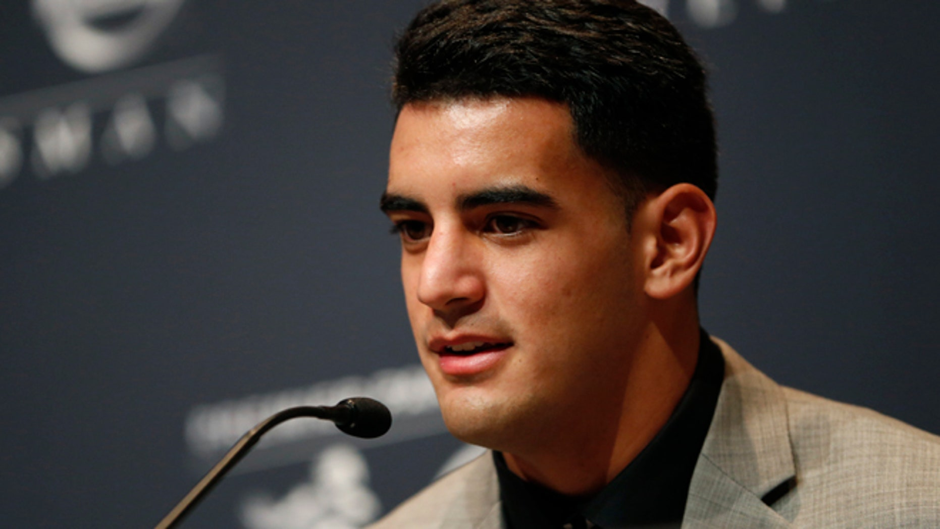 Dec. 13, 2014: Oregon quarterback Marcus Mariota talks during a news conference prior to the announcement of the Heisman Trophy winner in New York. (AP)