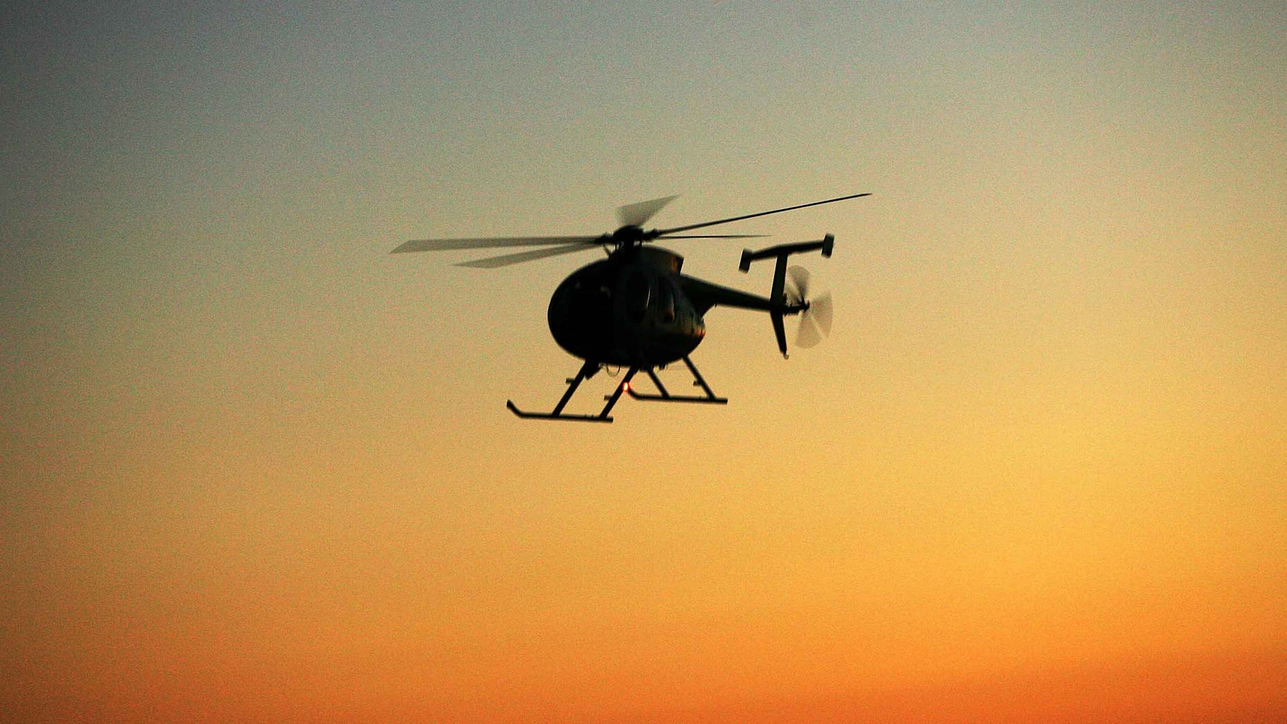 JACUMBA, CA - APRIL 8:  A Border Patrol helicopter flies along the border after sunset as the Minuteman Civil Defense Corps (MCDC) patrols the U.S.-Mexico border in search of illegal immigrants and drug smugglers April 8, 2006 near Jacumba, California. MCDC is conducting the patrols in all four U.S.-Mexico border states and in several places along the Canadian border throughout the month of April as Congress considers changes to immigration and border security laws. Late last week, a ?breakthrough? compromise Senate leaders announced in the overhaul of immigration law, that could have led to the passage of a bill that would give the nation's estimated 11 million-plus illegal immigrants a chance to obtain U.S. citizenship, fell apart before the start of the two-week Spring recess.  (Photo by David McNew/Getty Images)