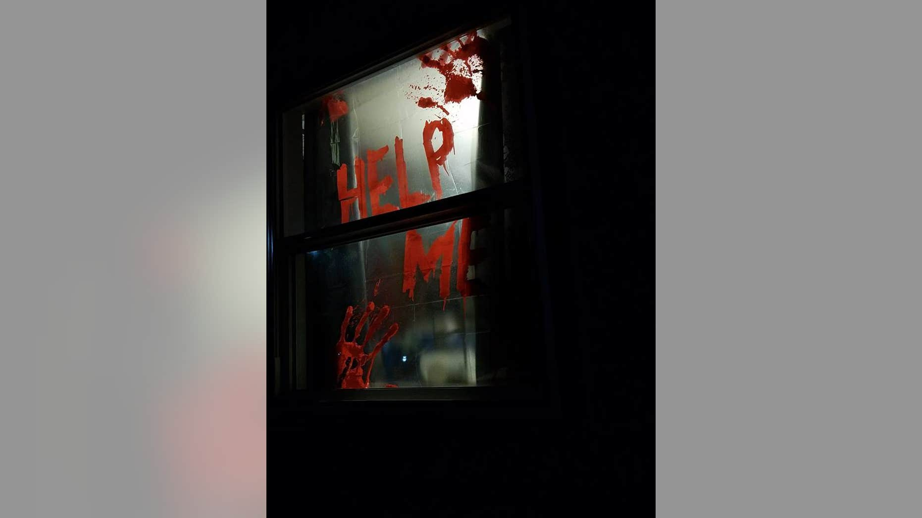 """Becky Muhs' """"Help Me"""" decoration proved to be just a bit too scary for the neighbors."""