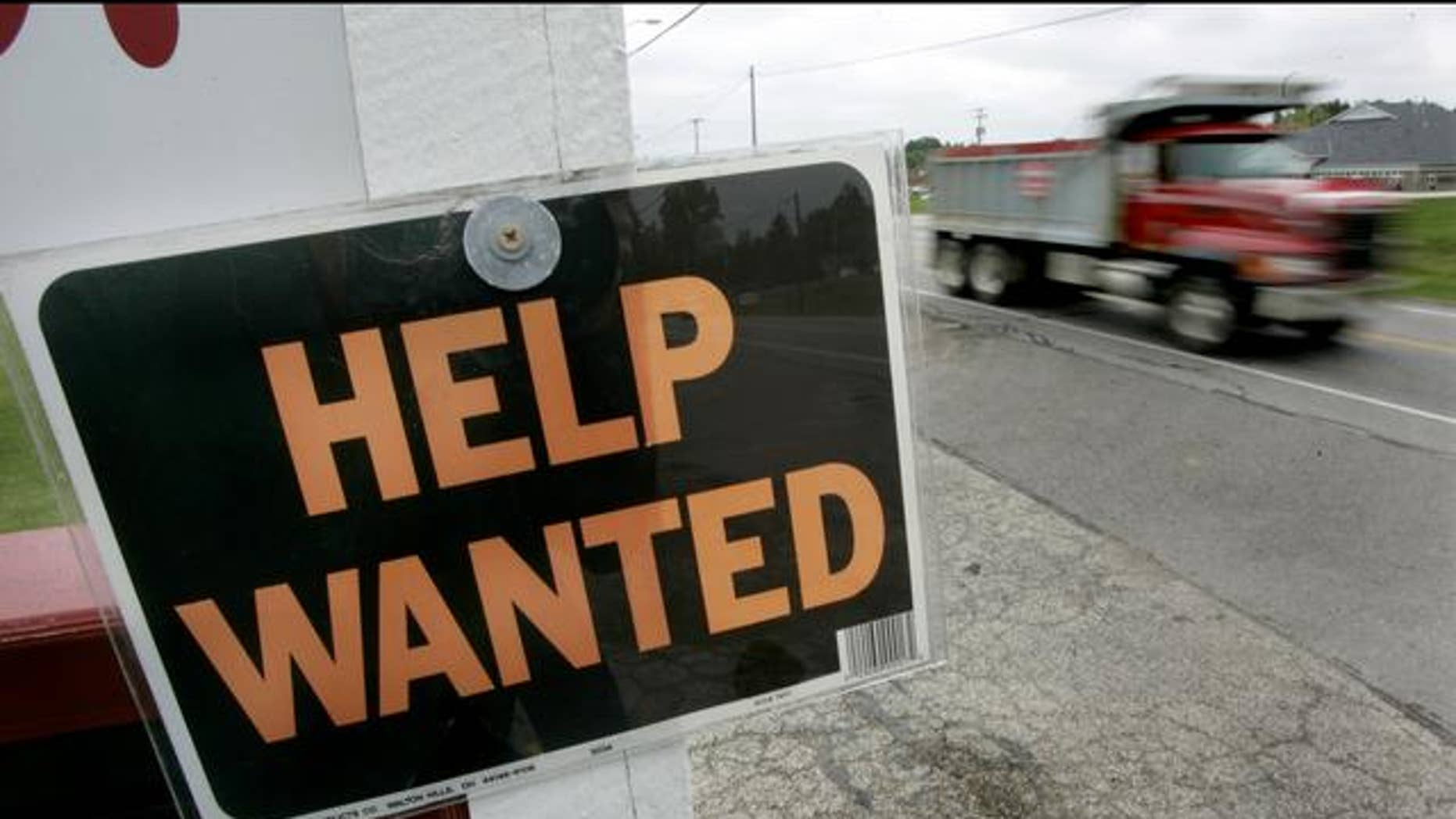 A landscaping company looks for help with a sign hung along a busy roadway in Chesterland, Ohio on Friday, June 3, 2005. Job growth slowed nearly to a crawl in May, with new hiring registering the smallest gain in two years, the Labor Department reported Friday.(AP Photo/Amy Sancetta)