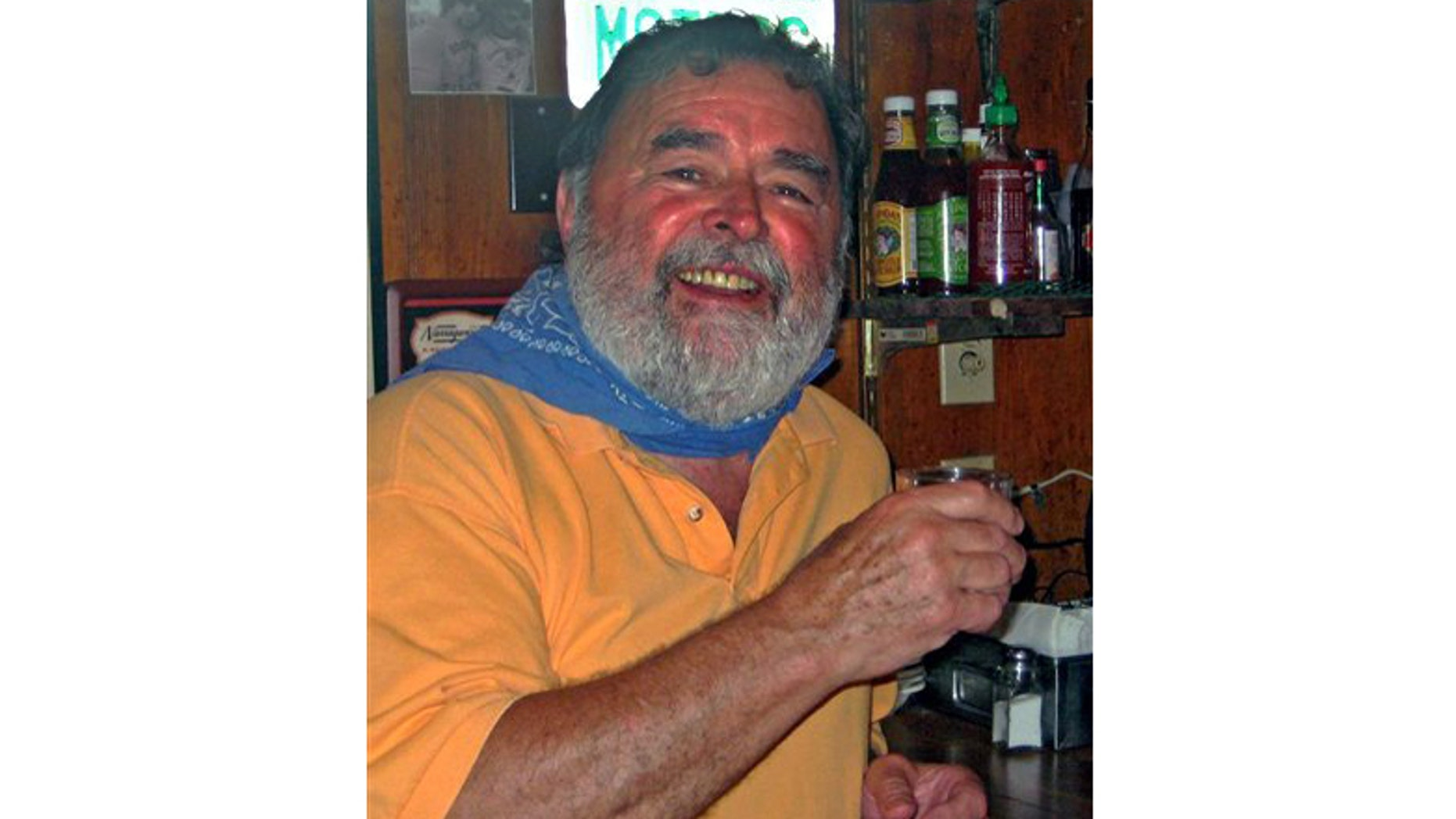 """July 2, 2012: Richard Costello poses in his restaurant in Chatham, Mass. after learning he had won a Facebook-based Virtual """"Papa"""" Hemingway Look-Alike Contest."""