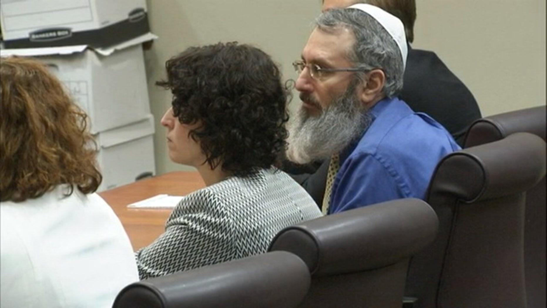 Hemy Neuman, right, in court.