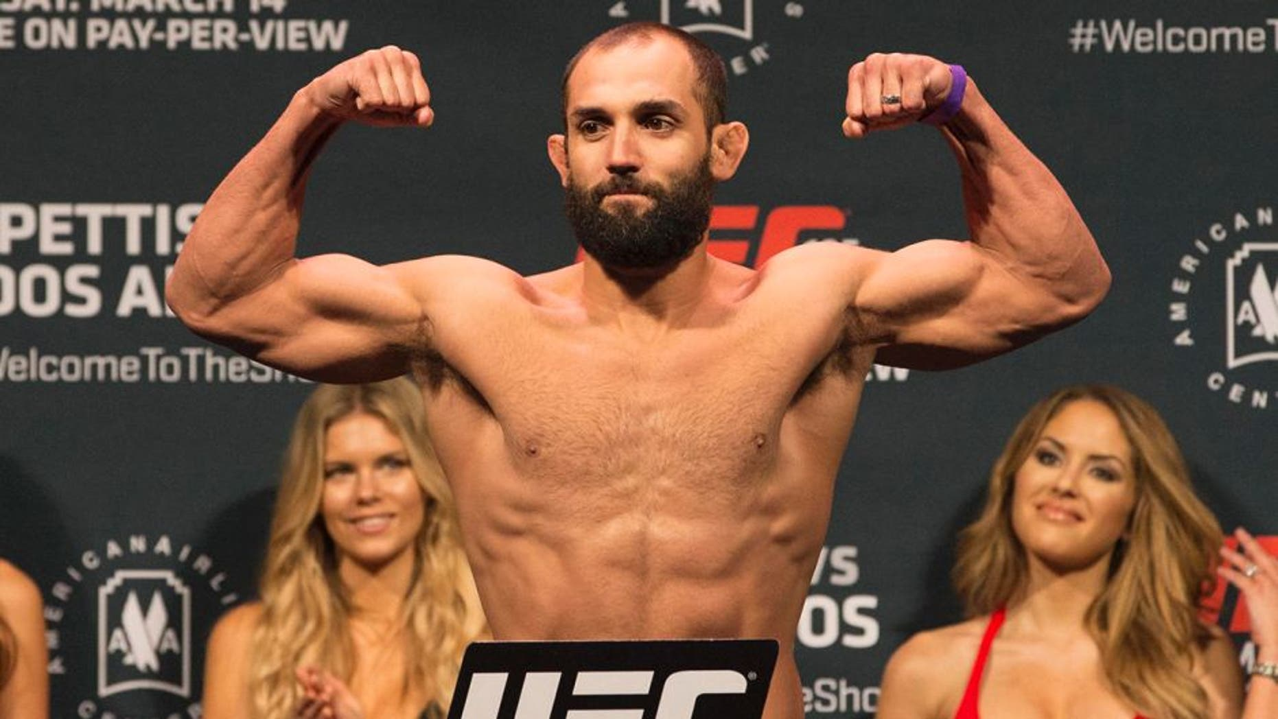 Mar 13, 2015; Dallas, TX, USA; Johny Hendricks stands on the scale during weigh-ins for UFC 185 at Kay Bailey Hutchison Convention Center. Mandatory Credit: Tim Heitman-USA TODAY Sports