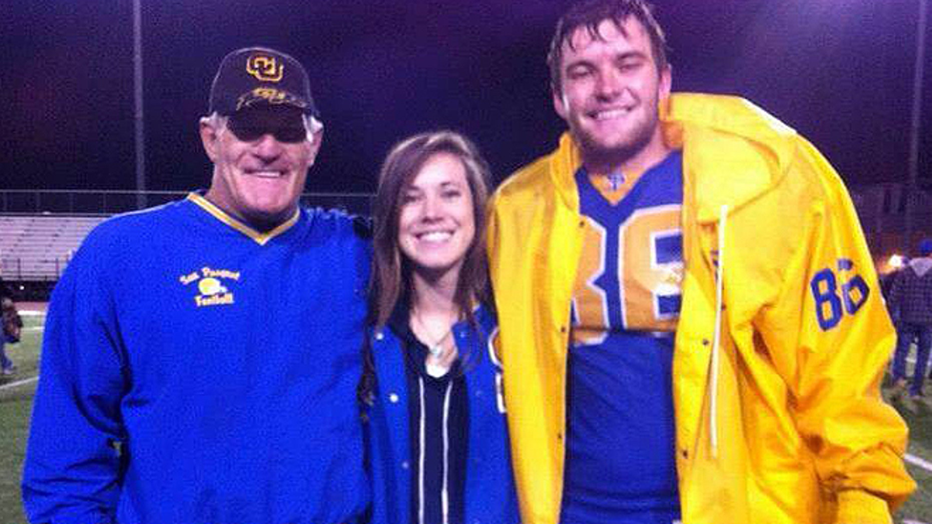 Steve Hendrickson, a former NFL linebacker who suffered at least 12 concussions during his 7-year career, stands with his daughter Courtney and son Kyle in an undated photograph. (Courtesy: Kyle Hendrickson)