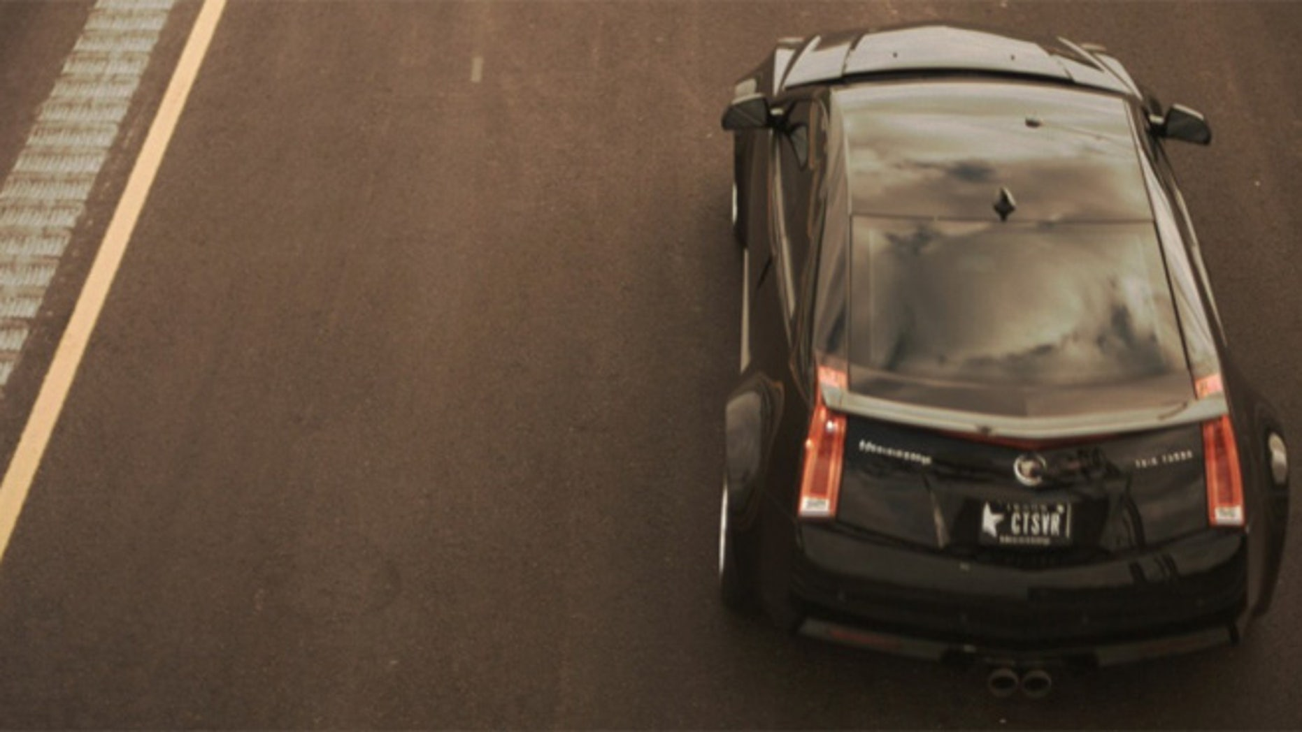 TxTag image of Hennessey Cadillac passing camera at over 180 mph.