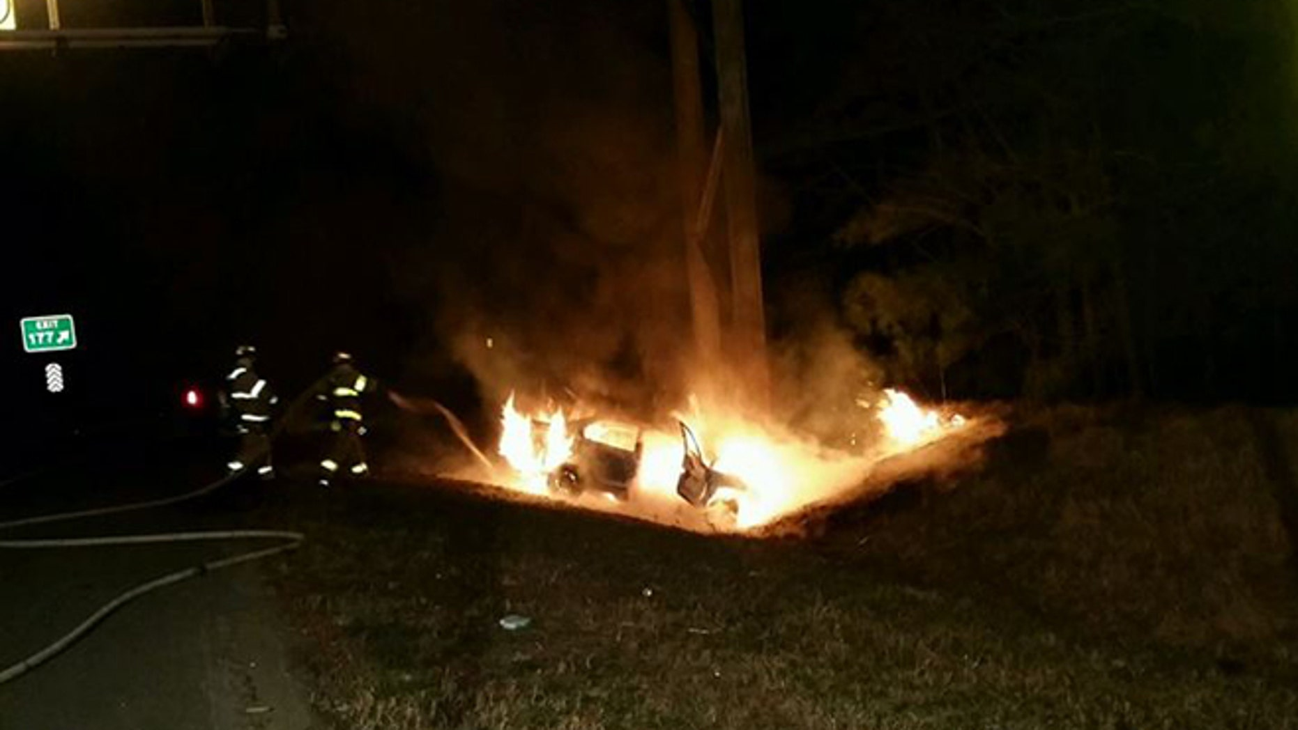 Firefighters extinguish fire on I-64 Saturday after Good Samaritan's dramatic rescue. (Henrico County Division of Fire)