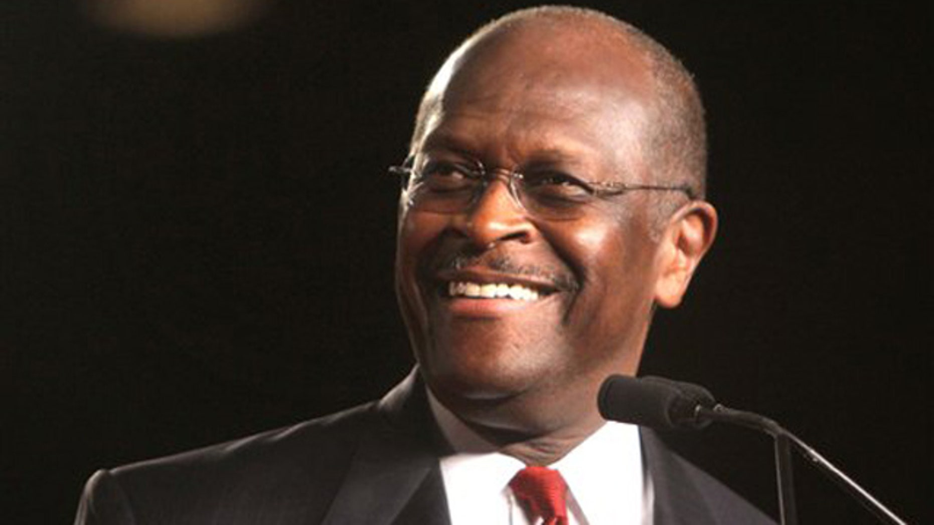 Republican presidential candidate Herman Cain arrives onstage to address the Conservative Political Action Conference (CPAC) at the Orange County Convention Center in Orlando, Fla., Friday, Sept. 23, 2011.