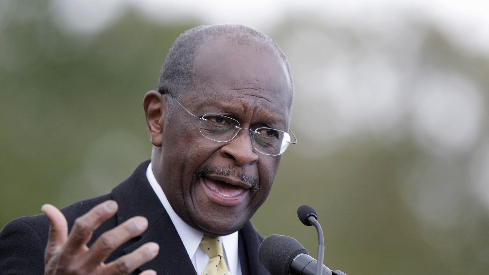 Republican presidential candidate, Herman Cain addresses the crowd during a campaign stop in Detroit, Friday, Oct. 21, 2011.