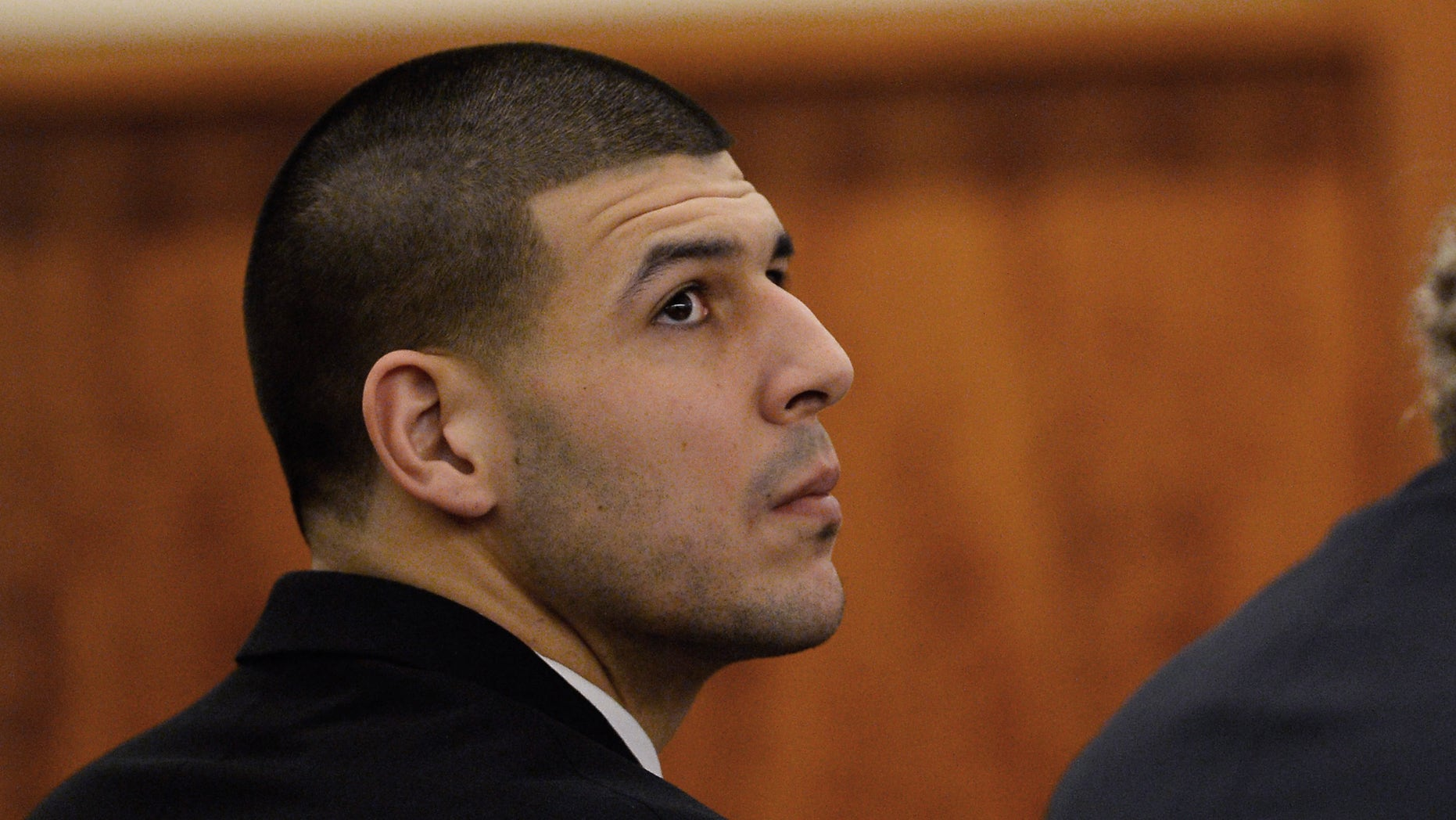 Jan. 6, 2015: Former New England Patriots football player Aaron Hernandez attends a pretrial hearing in the first of two murder cases against him at Bristol County Superior Court in Fall River, Mass.