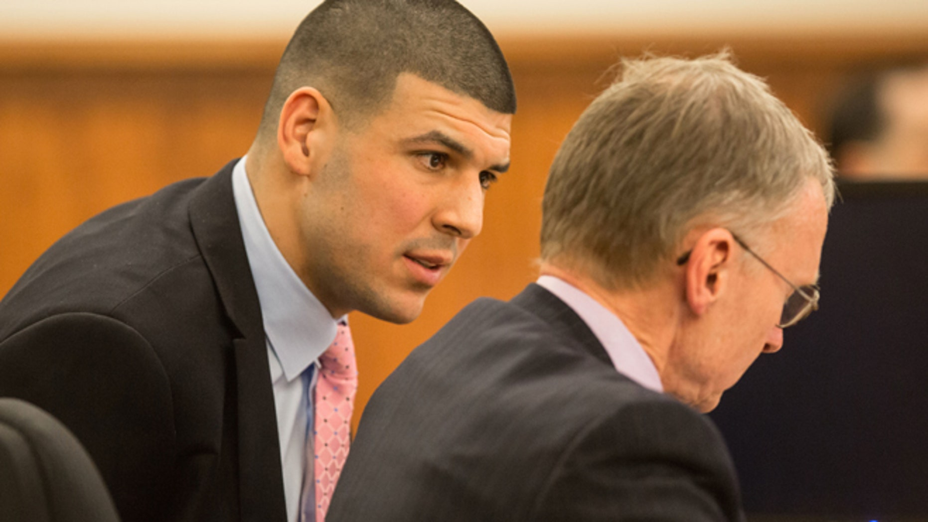 March 2: Former New England Patriots tight end Aaron Hernandez, left, speaks with his attorney Charles Rankin during his murder trial at Bristol County Superior Court in Fall River, Mass.