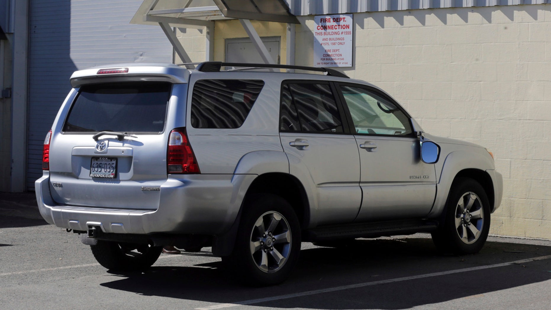 """In this March 3, 2017, file, photo, the Toyota 4Runner held in a Boston Police evidence lot in the Hyde Park neighborhood of Boston is seen during a """"view"""" of pertinent locations and evidence in the Aaron Hernandez trial."""