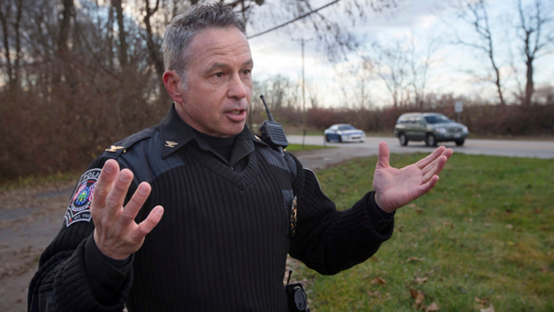 In this Dec. 18, 2015 file photo, the chief of police of the Newtown, Ohio, Police Department, Thomas Synan Jr., speaks to reporters at the scene of a traffic stop arrest in Newtown, Ohio.