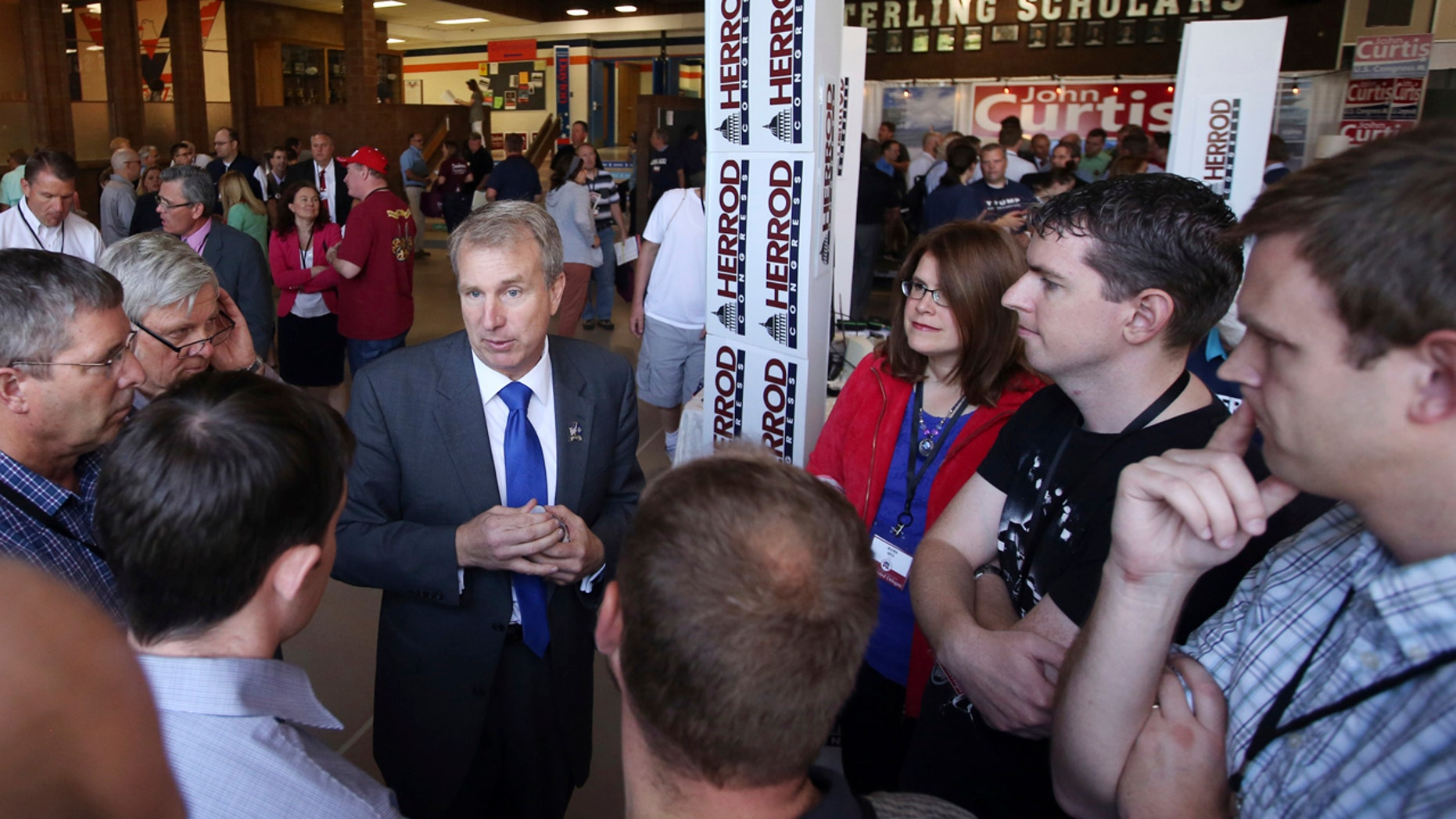 Former Utah lawmaker Chris Herrod, speaks with delegates before start of a 2017 special convention Saturday, June 17, 2017 in Provo, Utah