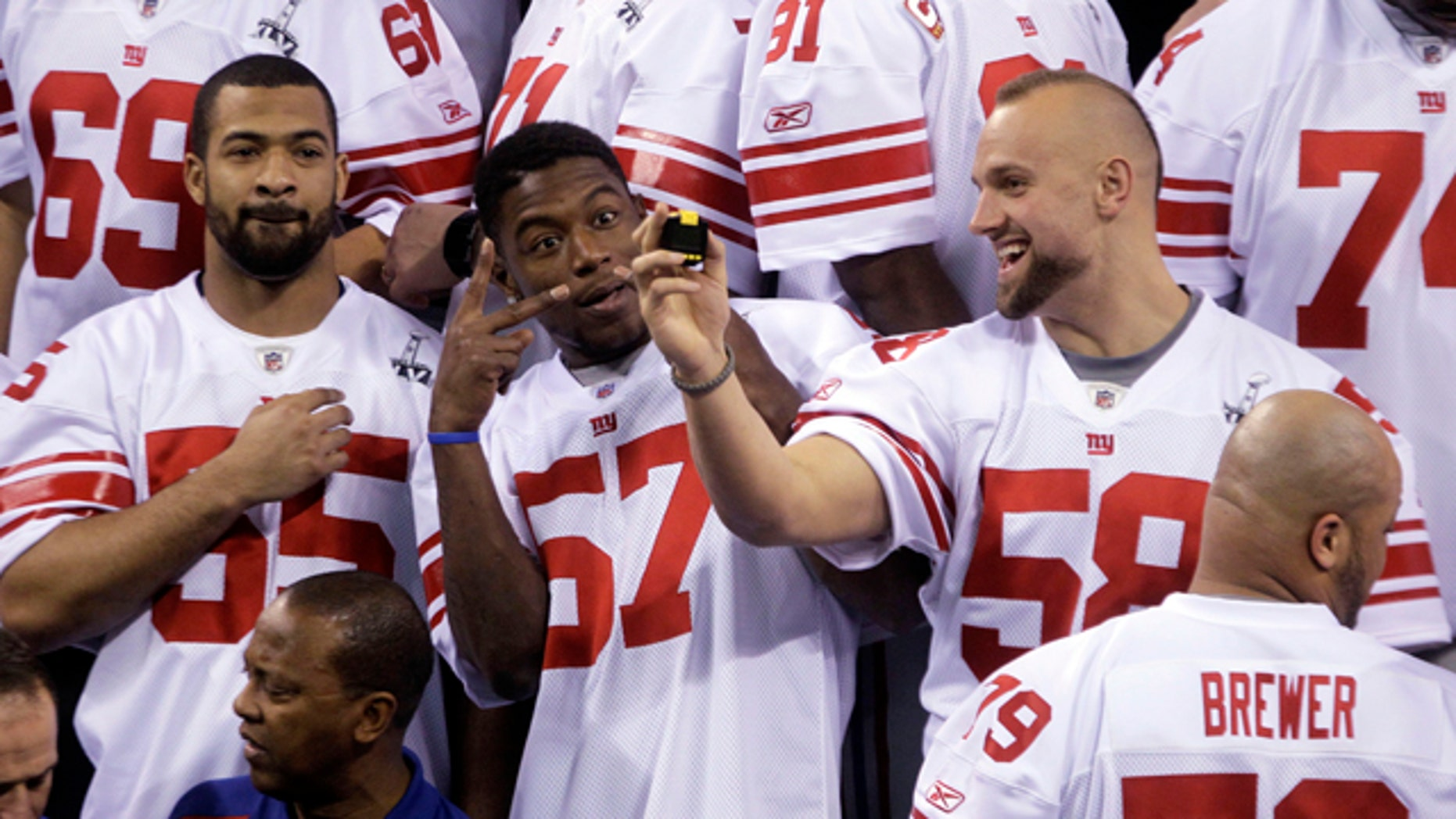 Jan. 31, 2012: New York Giants linebacker Spencer Paysinger (55), Jacquian Williams (57) and Mark Herzlich (58) have some fun during Media Day for NFL football's Super Bowl XLVI in Indianapolis.