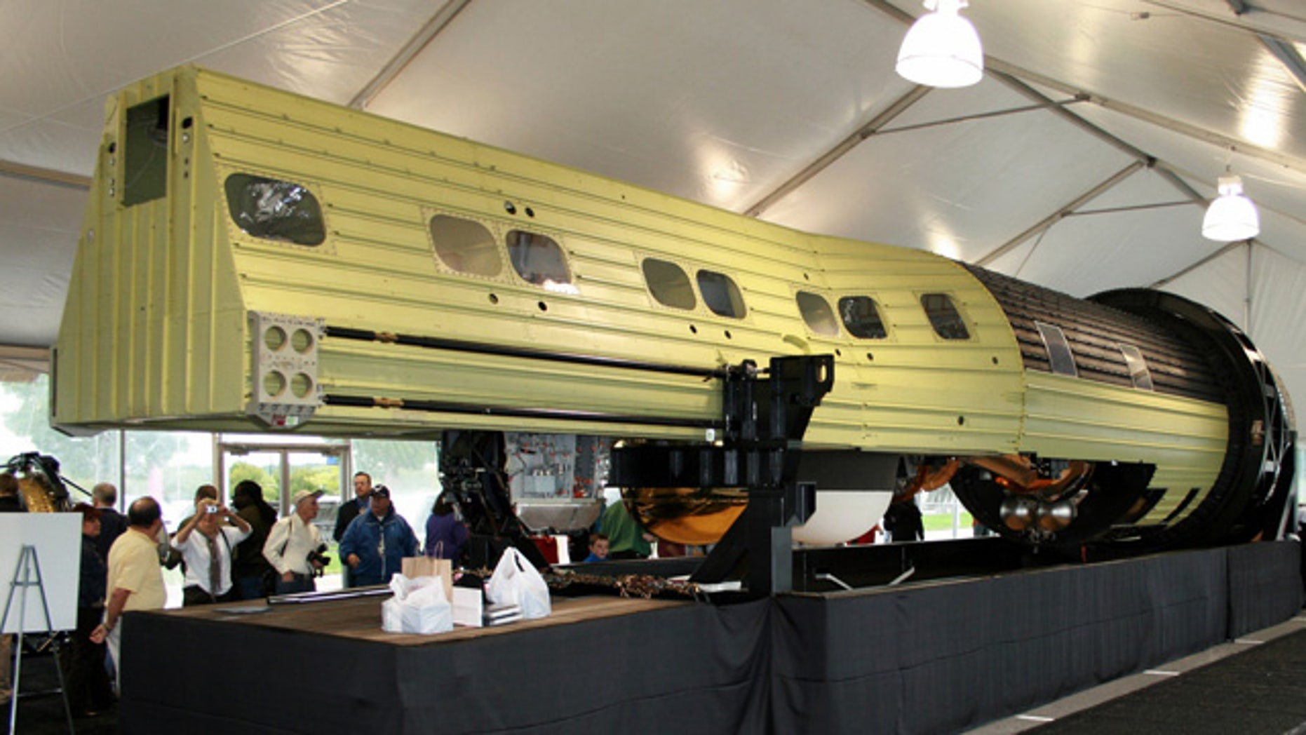 The massive KH-9 Hexagon spy satellite on display at the Smithsonian National Air & Space Museum's Udvar-Hazy Center, after being declassified on Sept. 17, 2011. Longer than a school bus at 60 feet in length and weighing 30,000 pounds at launch, 20 KH-9 Hexagons were launched by the National Reconnaissance Office between 1971 and 1986.