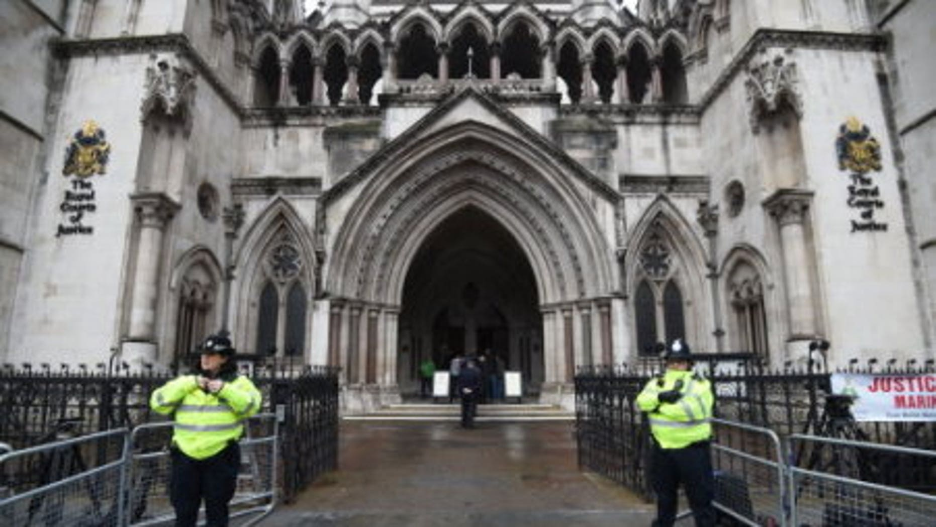 Police officers outside the High Court in central London, in February.