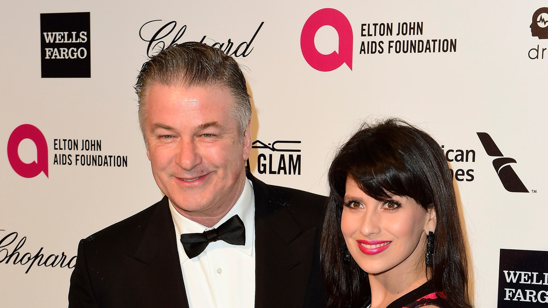 February 22, 2015. Actor Alec Baldwin and his wife Hilaria Thomas arrive at the 2015 Elton John AIDS Foundation Oscar Party in West Hollywood, California.