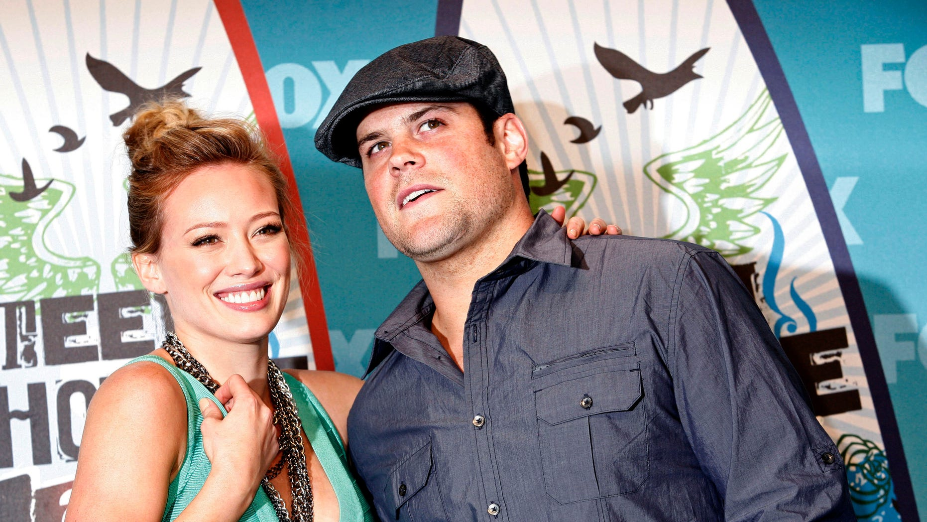 August 8, 2010. Actress and singer Hilary Duff and hockey player Mike Comrie pose in the press room at the Teen Choice 2010 Awards in Los Angeles.