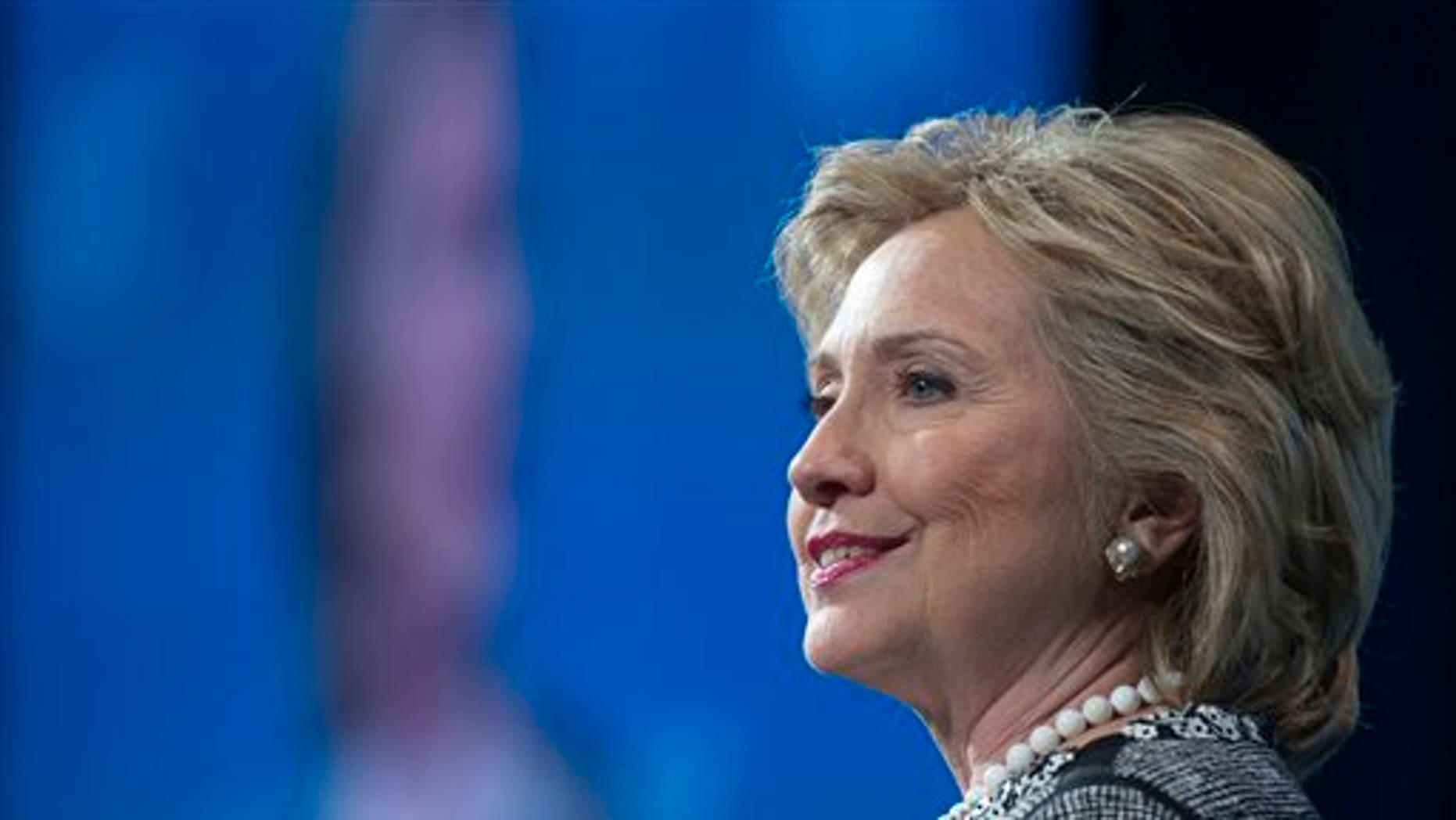 Former Secretary of State Hillary Rodham Clinton addresses the American Jewish Committee (AJC) Global Forum closing plenary in Washington, Wednesday, May 14, 2014. (AP Photo/Cliff Owen)