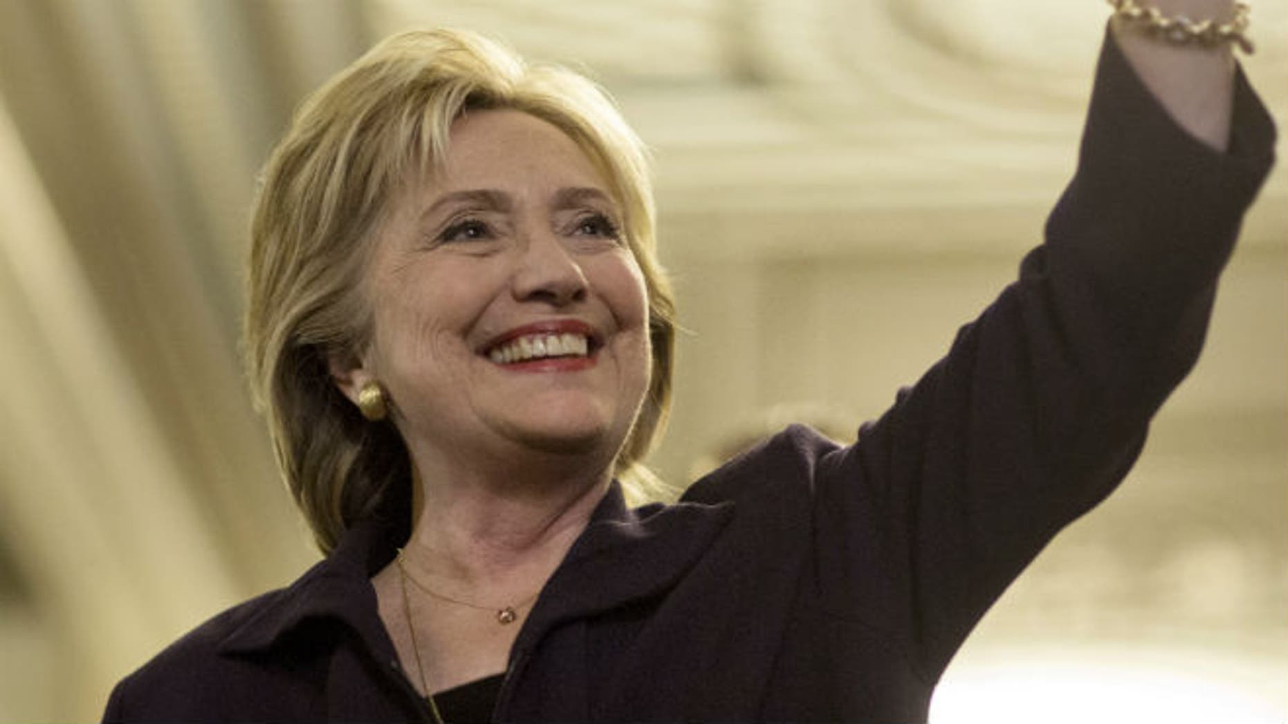 U.S. Democratic presidential candidate Hillary Clinton waves after testifying to the House Select Committee on Benghazi on Capitol Hill in Washington October 22, 2015. REUTERS/Joshua Roberts