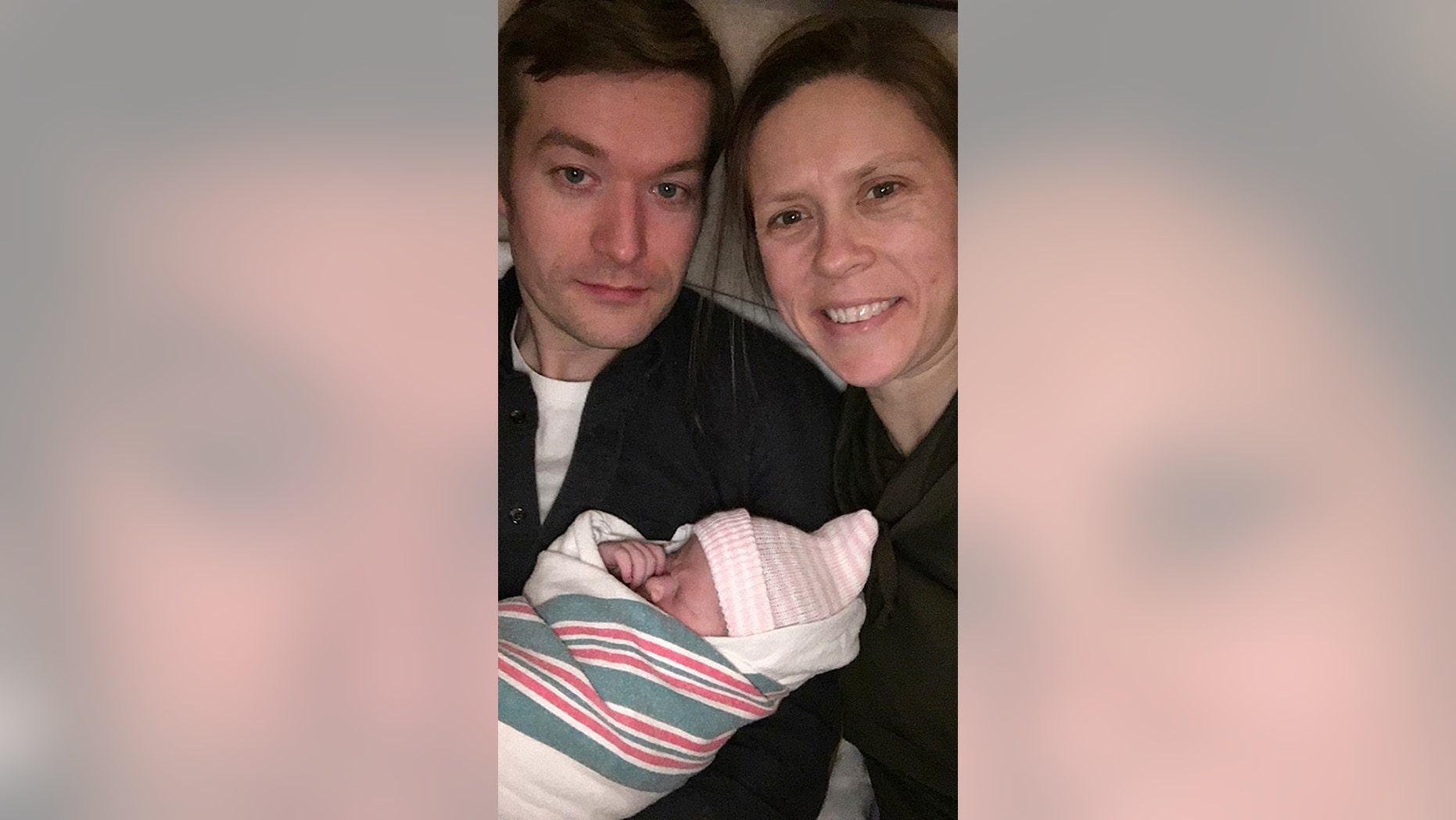 OB-GYN Hilary Conway is pictured with her husband and newborn daughter. She delivered her patient's twins just 14 hours after she gave birth.
