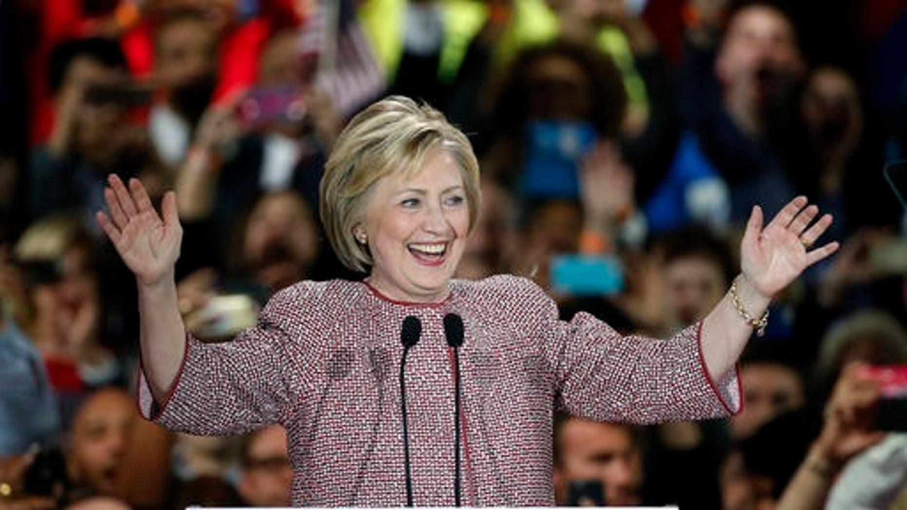 Democratic presidential candidate Hillary Clinton celebrates on stage after winning the New York state primary Tuesday, April 19, 2016, in New York. (AP Photo/Kathy Willens)