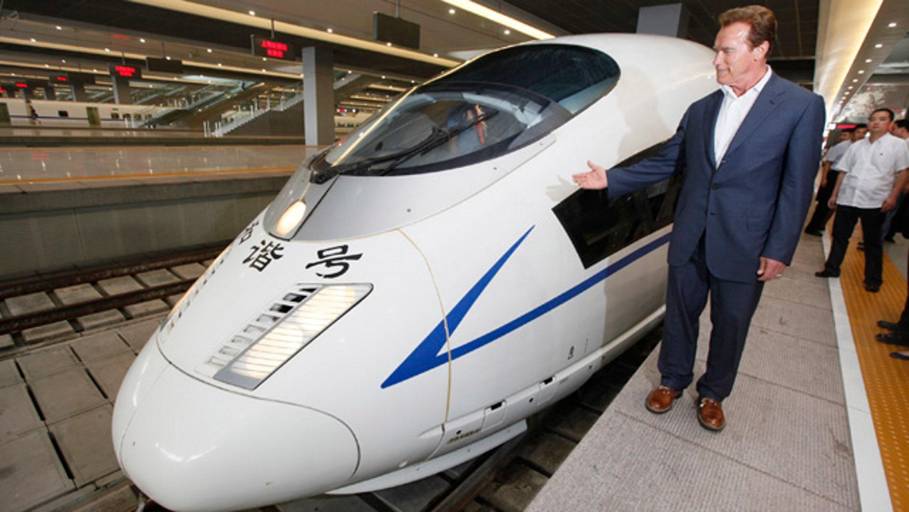 California Gov. Arnold Schwarzenegger admires China's high-speed train at Hongqiao Railway Station in Shanghai, China, Sunday, Sept. 12, 2010.