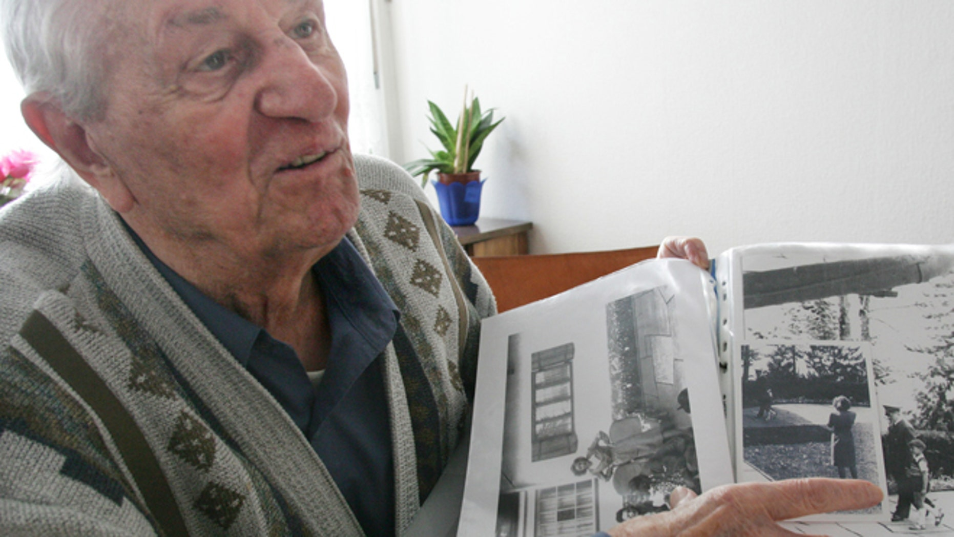FILE 2005: Rochus Misch points on a picture of Adolf Hitler he had taken in Berchtesgarden, southern Germany.