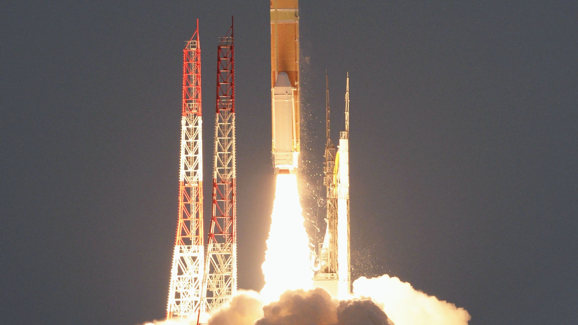 """In this Feb. 17, 2016 photo, an H-2A rocket carrying an X-ray astronomy satellite called """"Hitomi"""", is launched from the Tanegashima Space Center in Kagoshima Prefecture, southern Japan. (Kyodo News via AP)"""