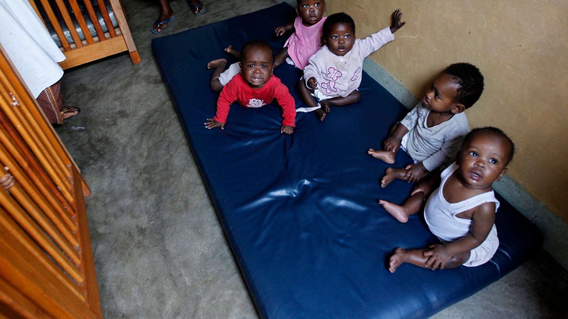 Abandoned children play at the Don Bosco Ngangi community center in the Democratic Republic of the Congo. The center was established in 1988 and hosts over 3,000 abandoned children and HIV/AIDS victims.(REUTERS/Thomas Mukoya)