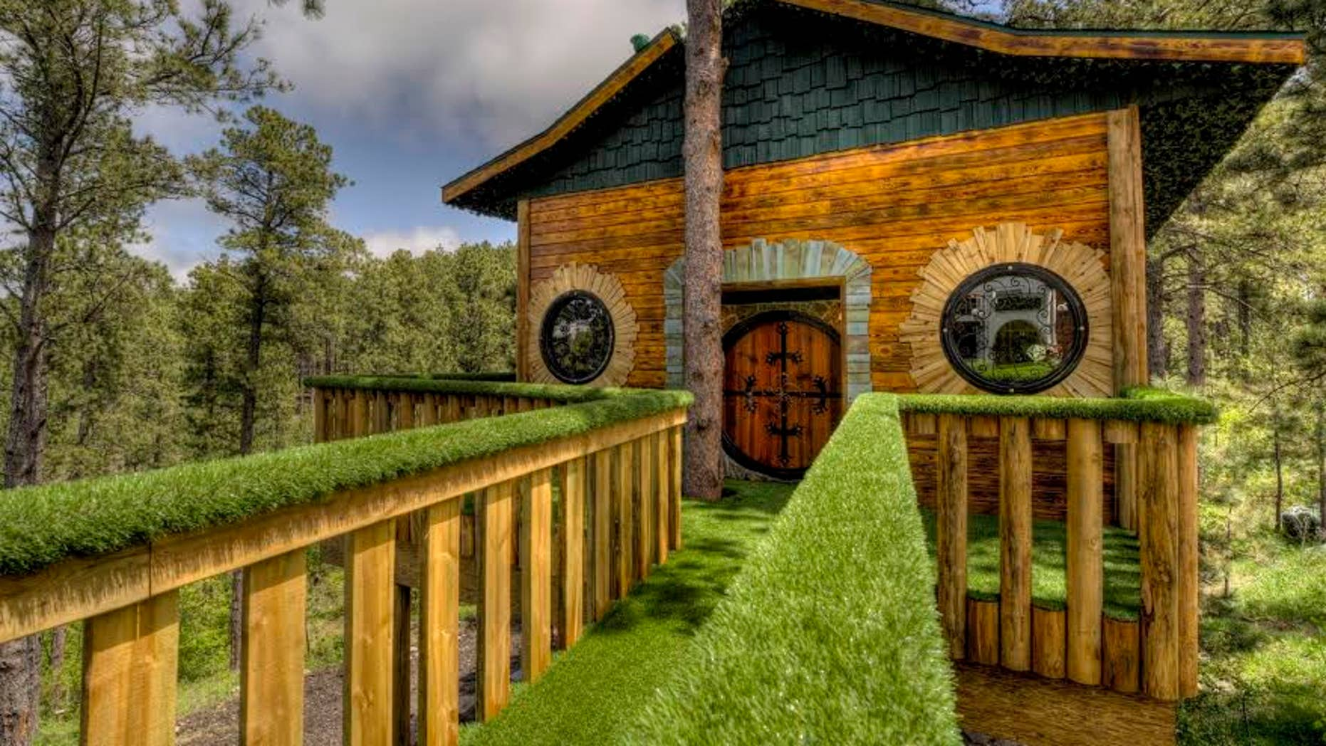 A walkway connects the original property to the Hobbit-themed treehouse.