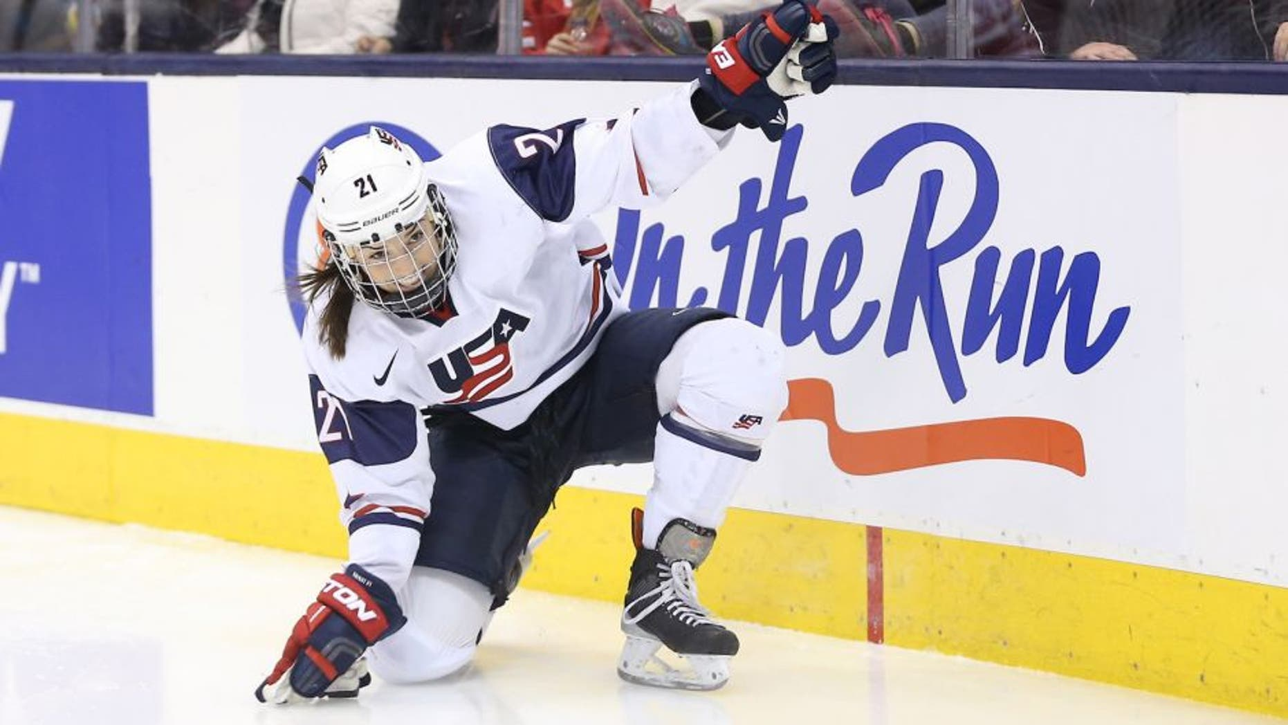 Dec 30, 2013; Toronto, Ontario, Canada; USA left wing Hilary Knight (21) celebrates after scoring a goal against Canada during the second period in an exhibition hockey game at Air Canada Centre. USA won 3-2. Mandatory Credit: Tom Szczerbowski-USA TODAY Sports
