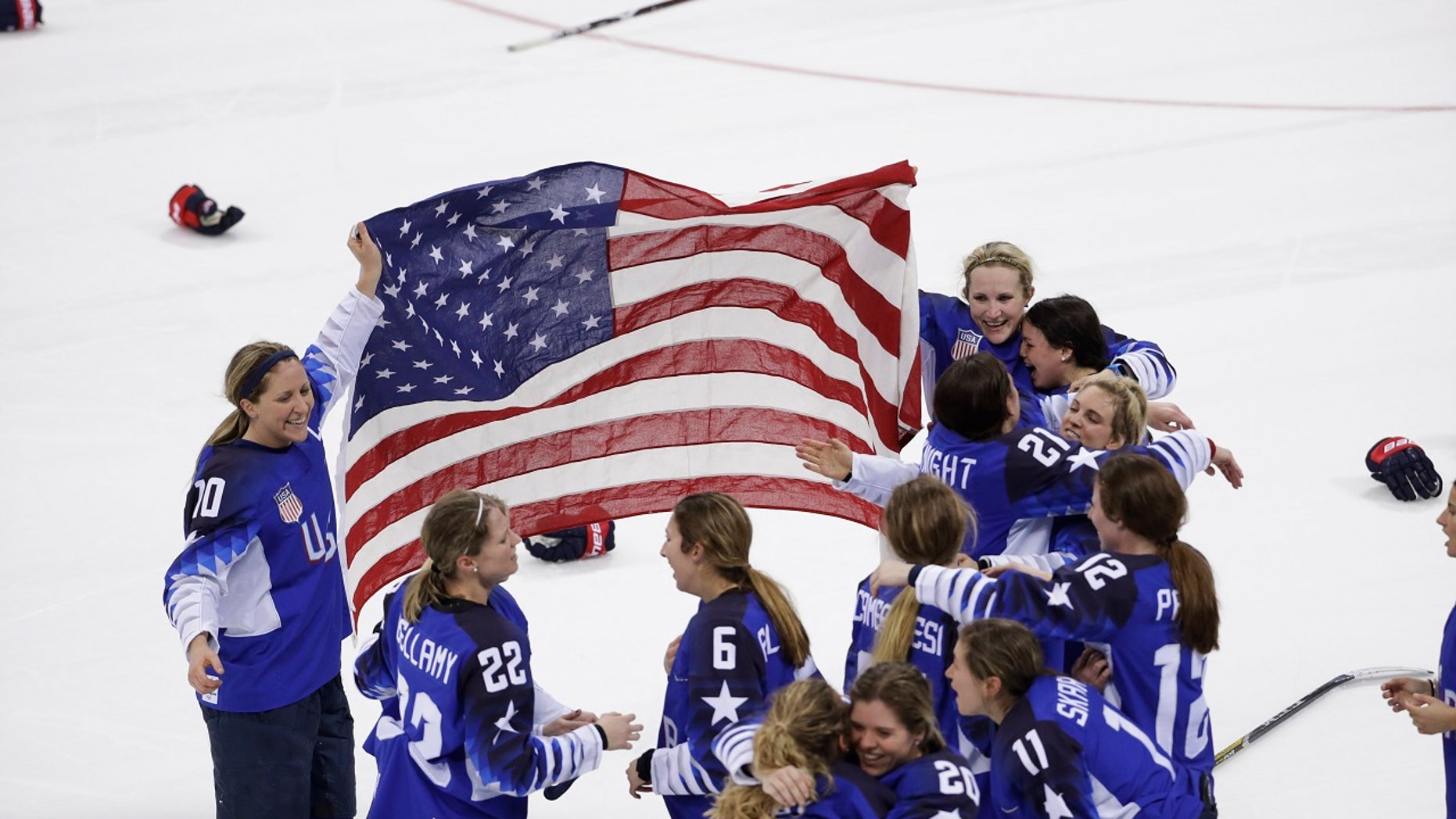 United States celebrates winning gold after the women's gold medal hockey game against Canada at the 2018 Winter Olympics in Gangneung, South Korea
