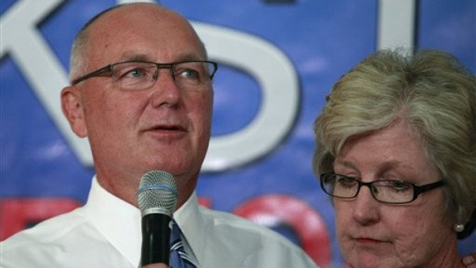 In this Aug. 3, 2010, photo, then-Rep. Pete Hoekstra stands with his wife, Diane, as he concedes during an election gathering for the Michigan gubernatorial primary in Hudsonville, Mich.