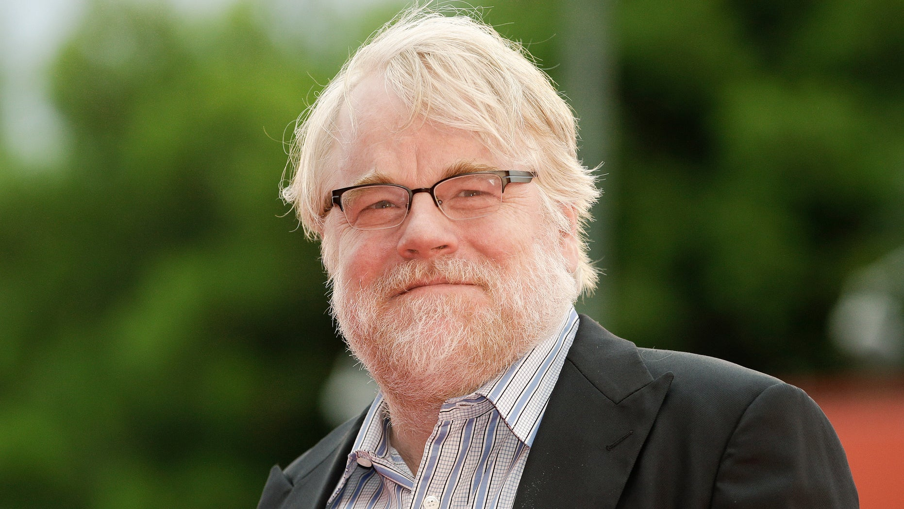 """September 1, 2012.  Philip Seymour Hoffman poses on the red carpet during a screening for the movie """"The Master""""at the 69th Venice Film Festival in Venice."""