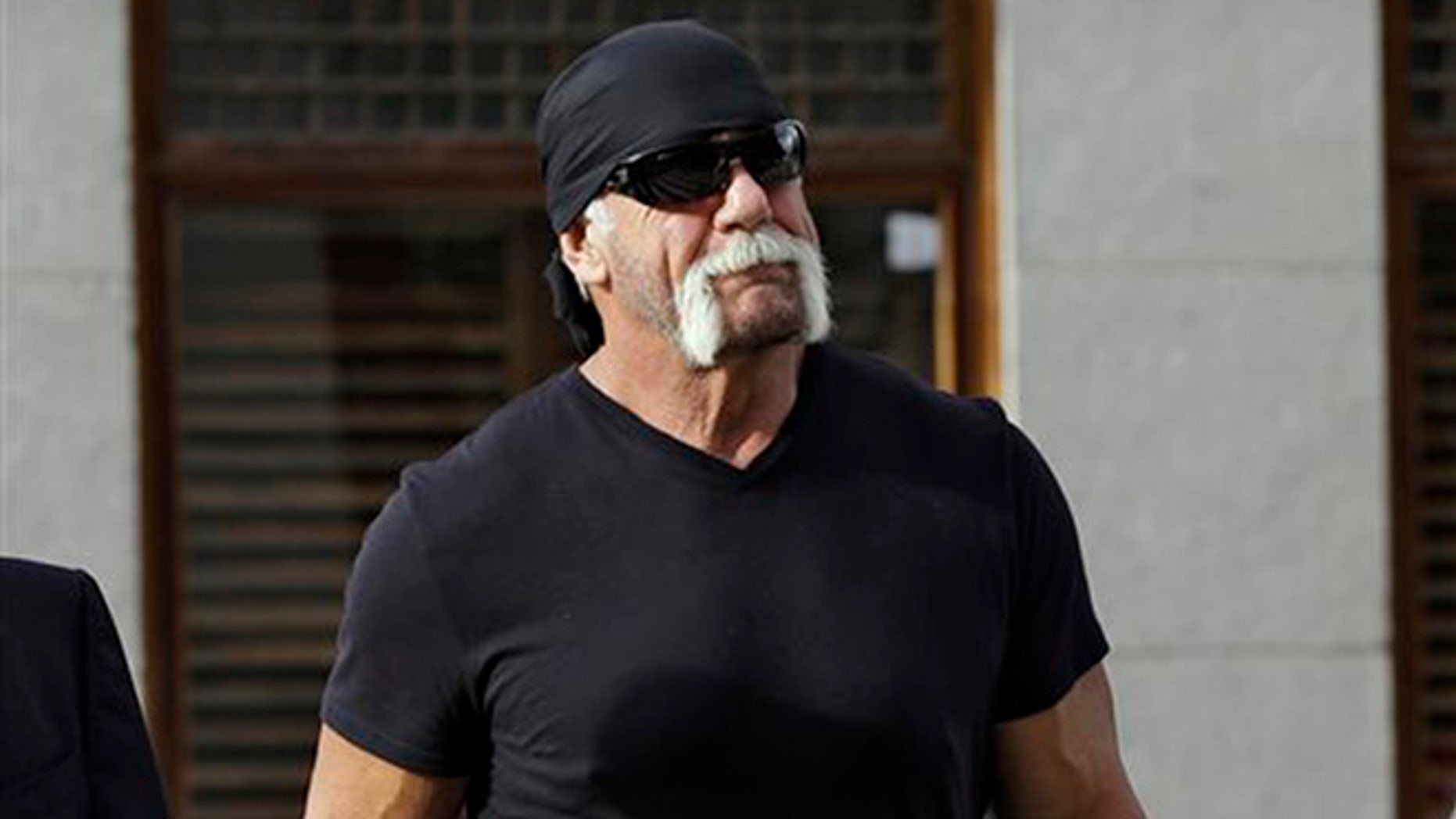 In this Oct. 15, 2012 file photo, former professional wrestler Hulk Hogan, whose real name is Terry Bollea, arrives for a news conference at the United States Courthouse in Tampa, Fla.