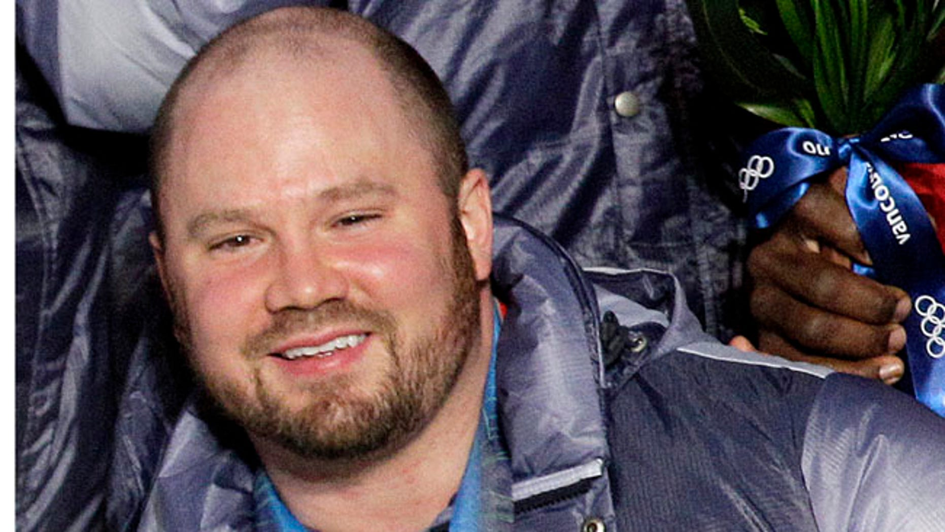 FILE - In this Feb. 27, 2010, file photo, Steven Holcomb, of the United States, poses with his gold medal in the men's four-man bobsled during the medal ceremony at the Vancouver 2010 Olympics in Whistler, British Columbia.  Holcomb, the longtime U.S. bobsledding star who drove to three Olympic medals after beating a disease that nearly robbed him of his eyesight, was found dead in Lake Placid, N.Y., on Saturday, May 6, 2017.  He was 37. (AP Photo/Jin-man Lee, File)