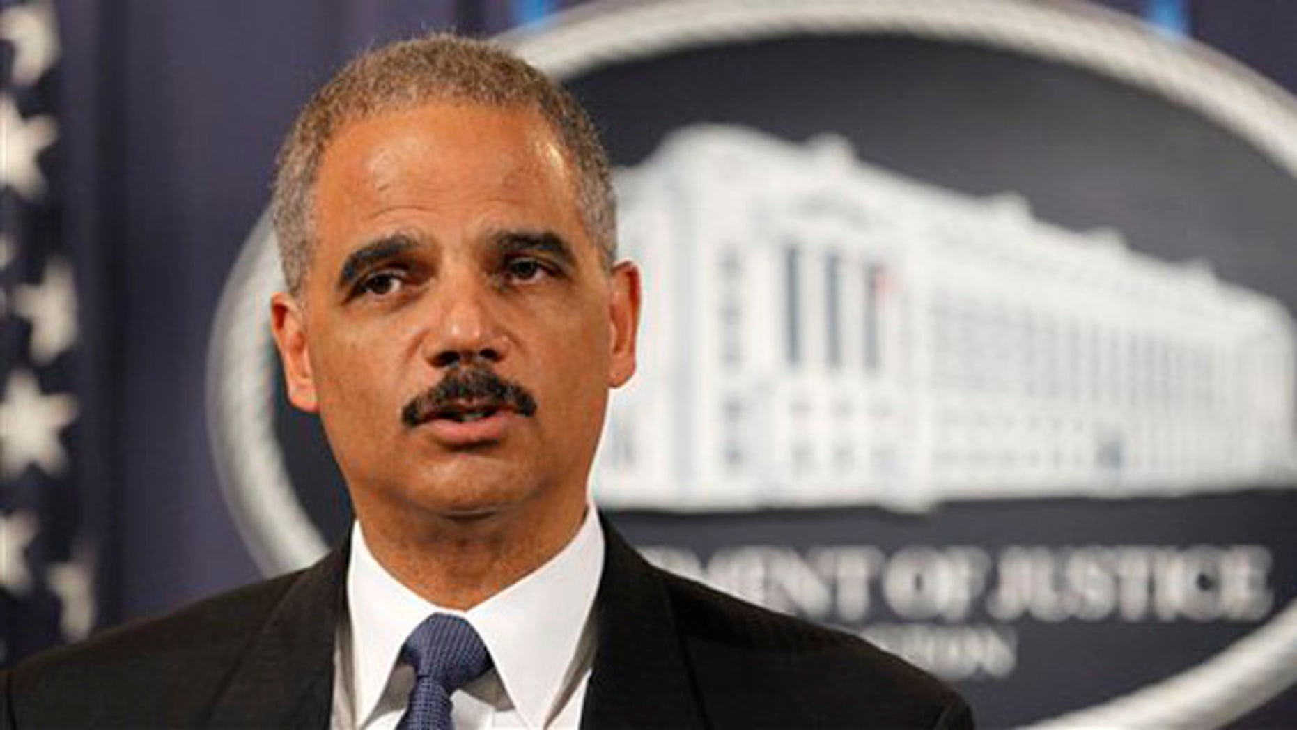 Attorney General Eric Holder speaks during a news conference at the Justice Department in Washington Oct. 11.
