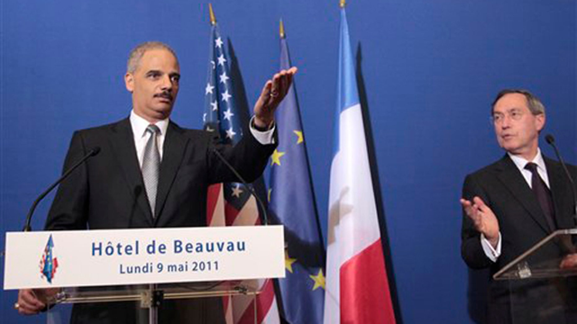 Attorney General Eric Holder, left, gestures during a press conference following a meeting with French Interior Minister Claude Gueant in Paris May 9.