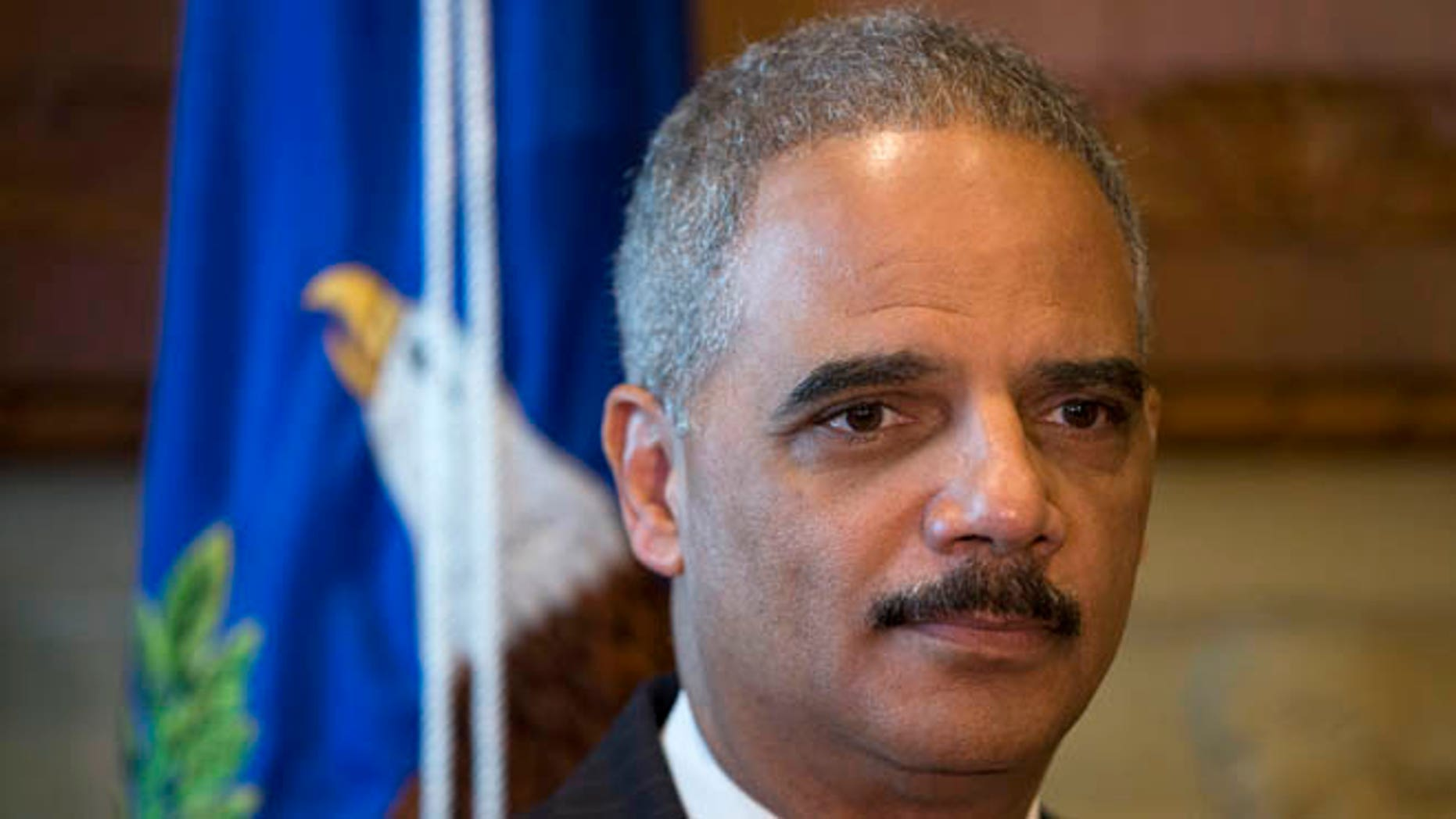 May 21, 2014: Attorney General Eric Holder pauses during a meeting at the Justice Department in Washington.