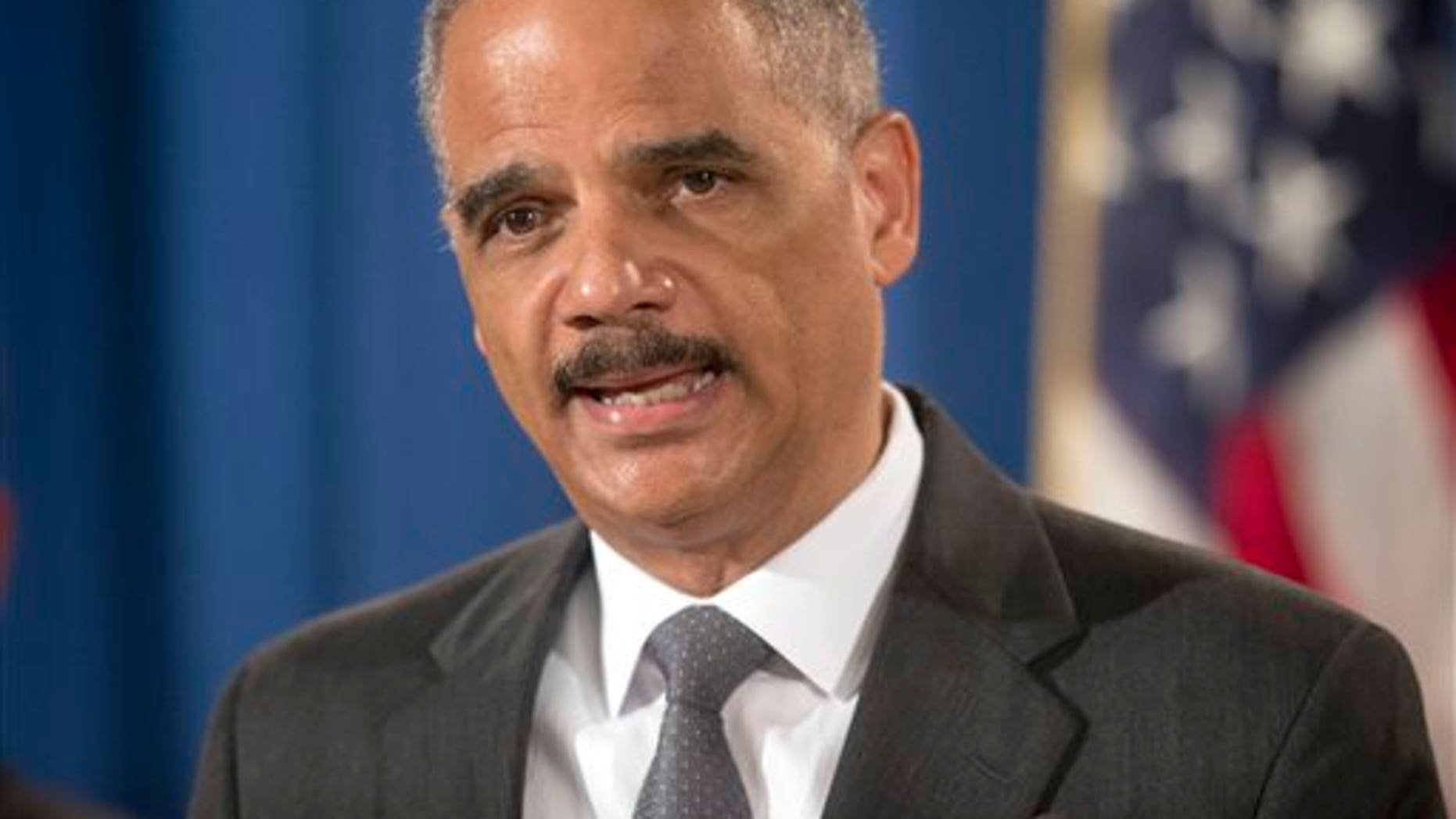 Attorney General Eric Holder announces at the Justice Department in Washington Monday, July 14, 2014, that Citigroup will pay $7 billion to settle an investigation into risky subprime mortgages. (AP Photo/Pablo Martinez Monsivais)