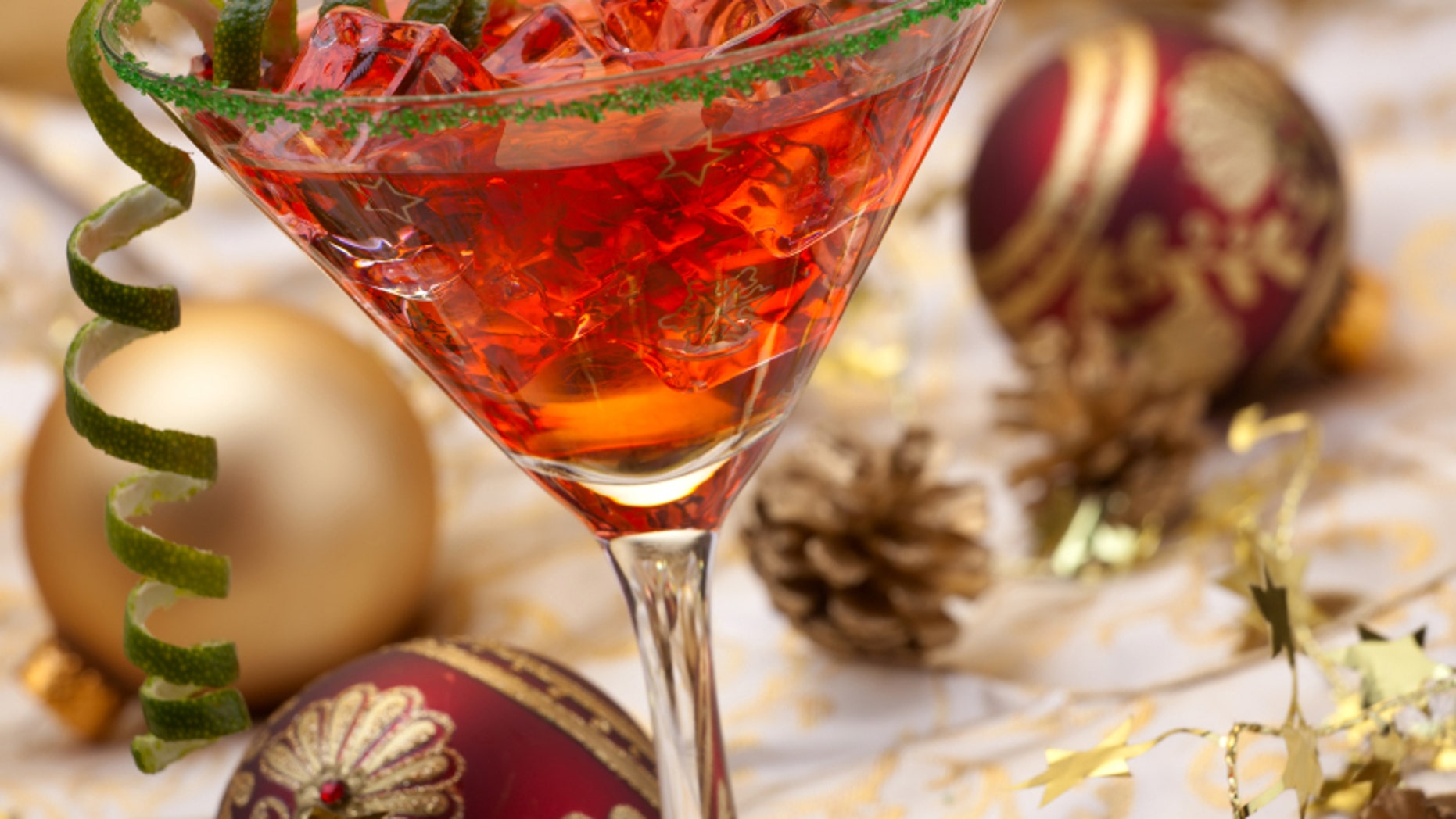 Glass of Christmas Cocktail in martini glass and Christmas ornaments